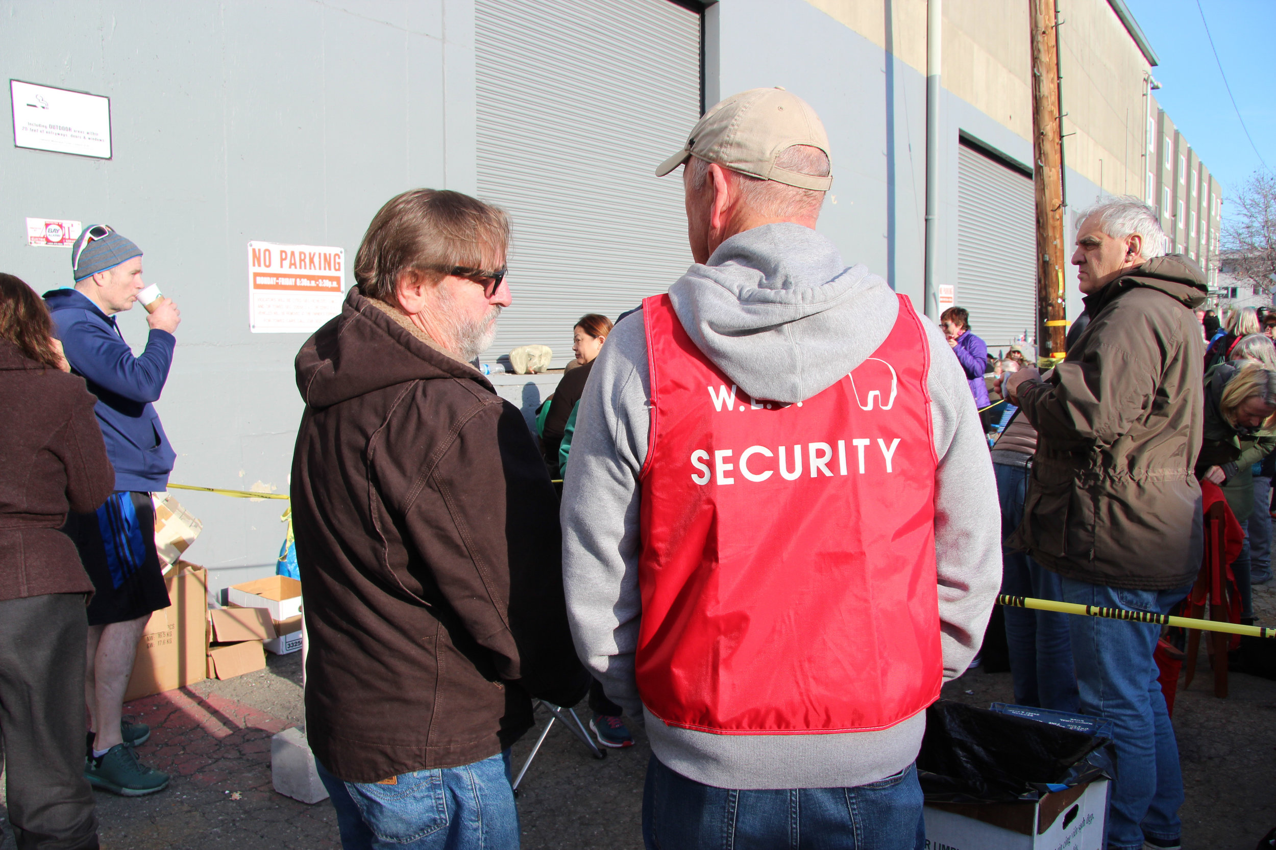 The White Elephant Sale has security to check wristbands and manage the flow of people.
