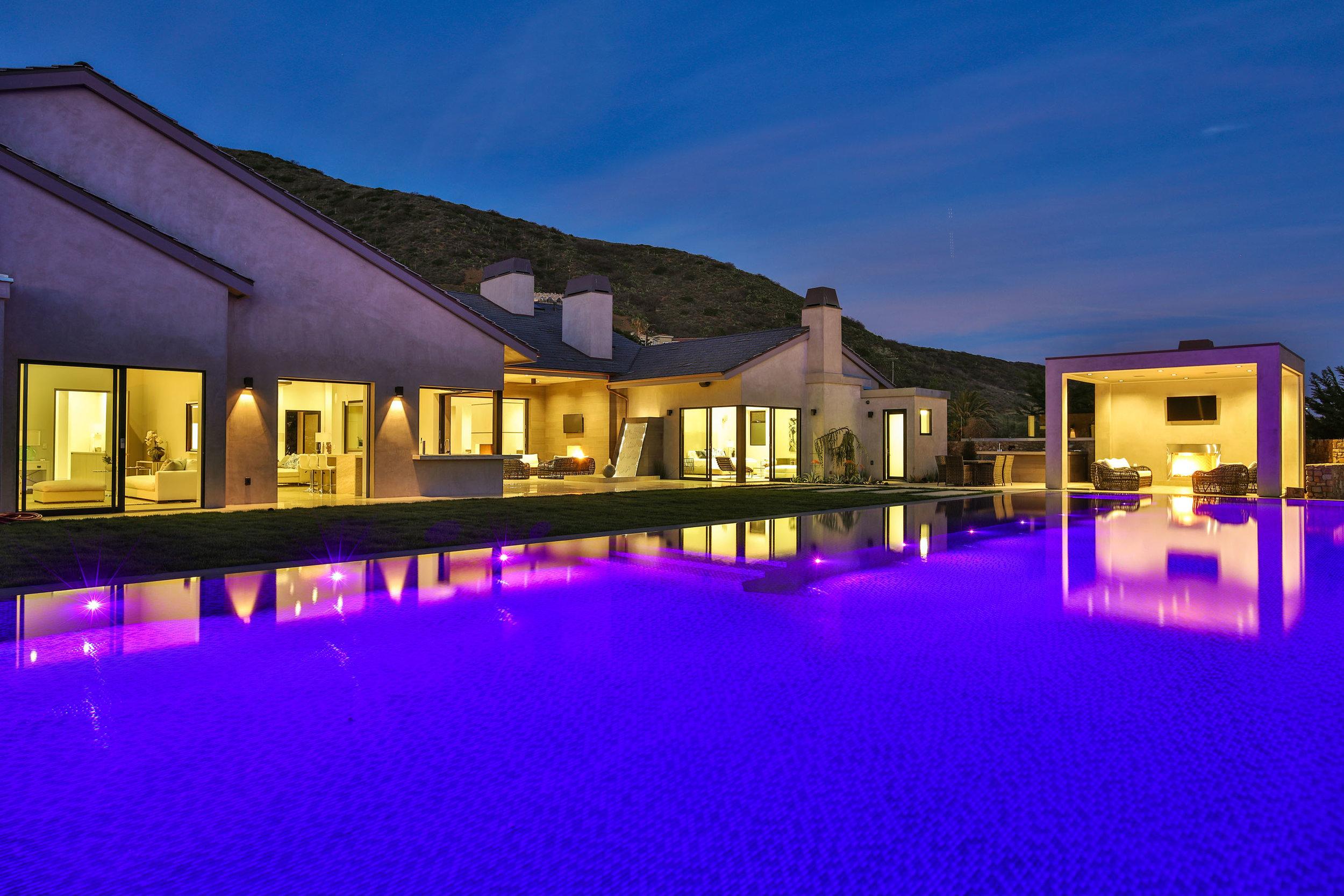 026 pool house night 11902 Ellice Street Malibu For Sale The Malibu Life Team Luxury Real Estate.jpg