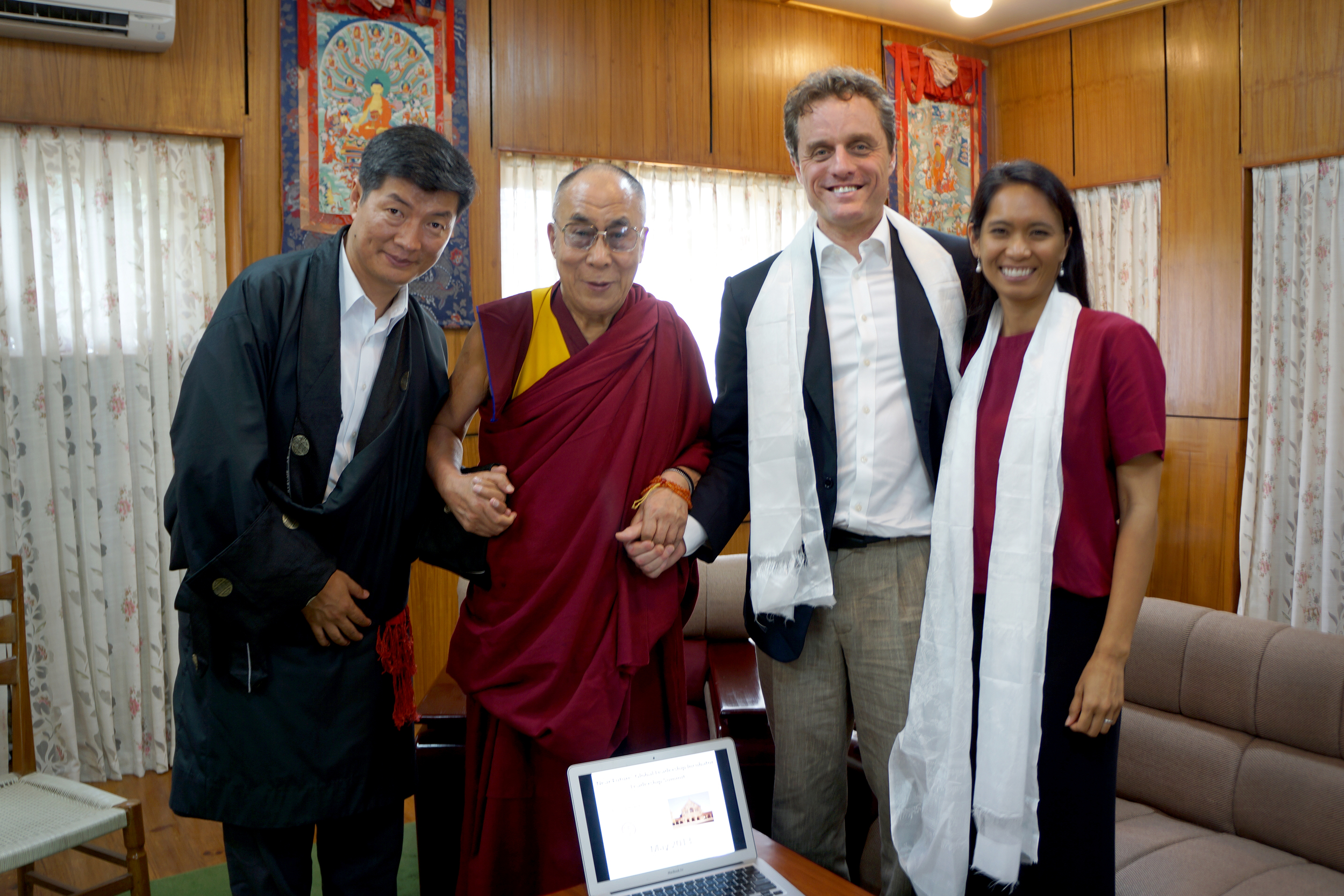 Sikyong Lobsang Sangay (left), His Holiness the Dalia Lama (center left), Dr. Michael McCullough (center right), and Ana Rowena McCullough (right) stand for a picture