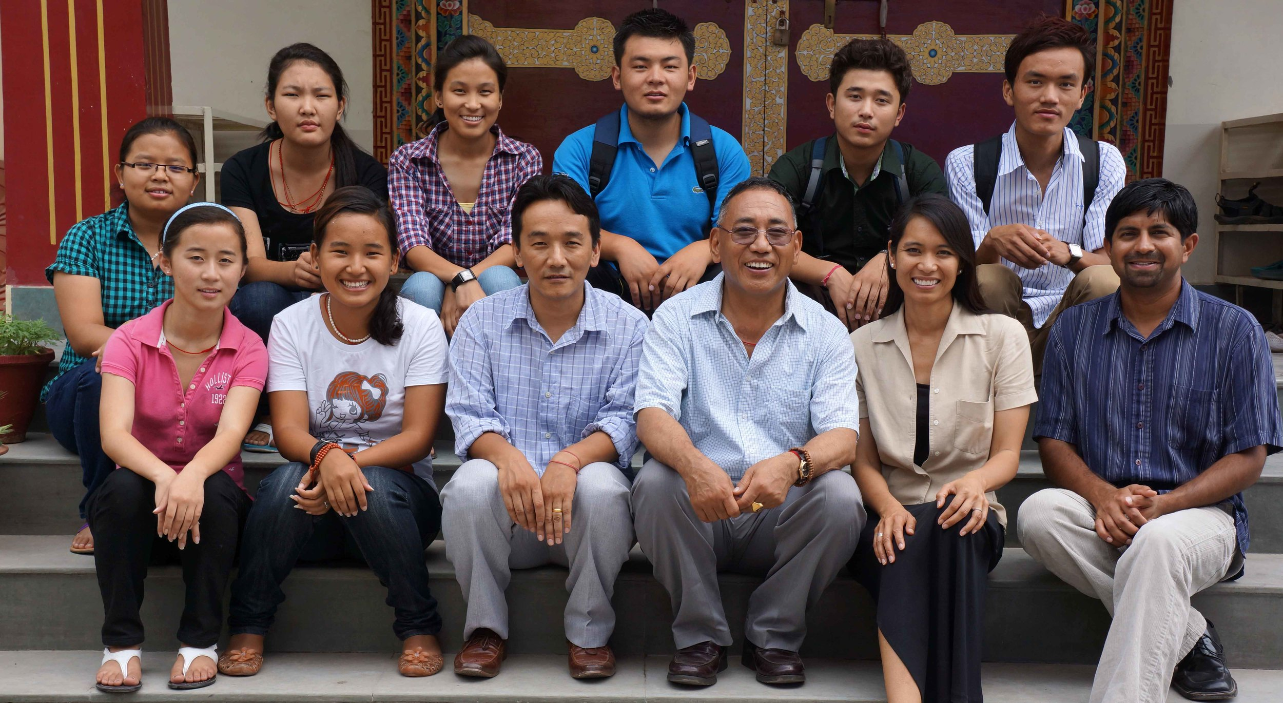 Ana Rowena McCullough sitting with a group of Tibetan students and others