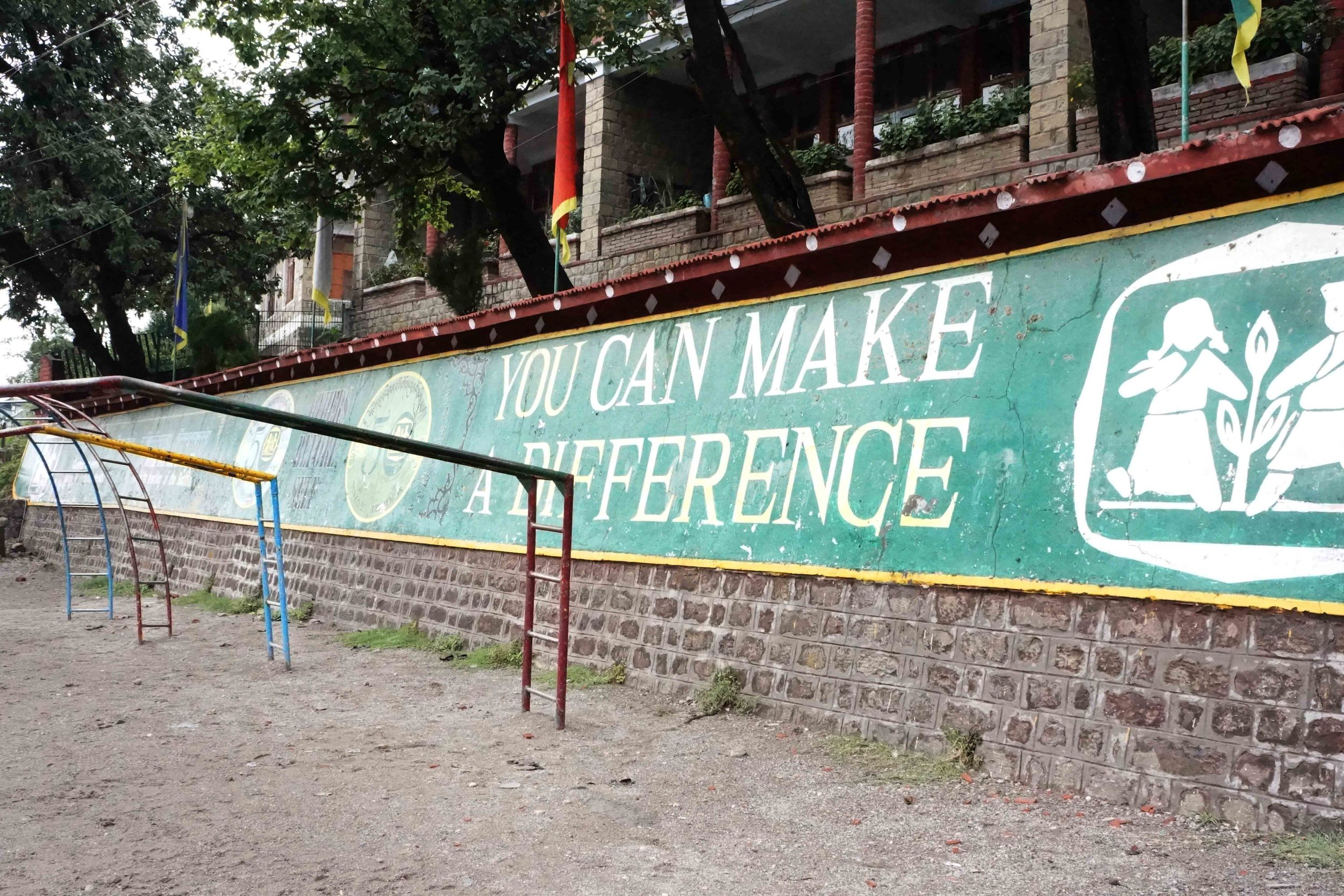 "A sign, white text on green, reading ""You can make a difference."""