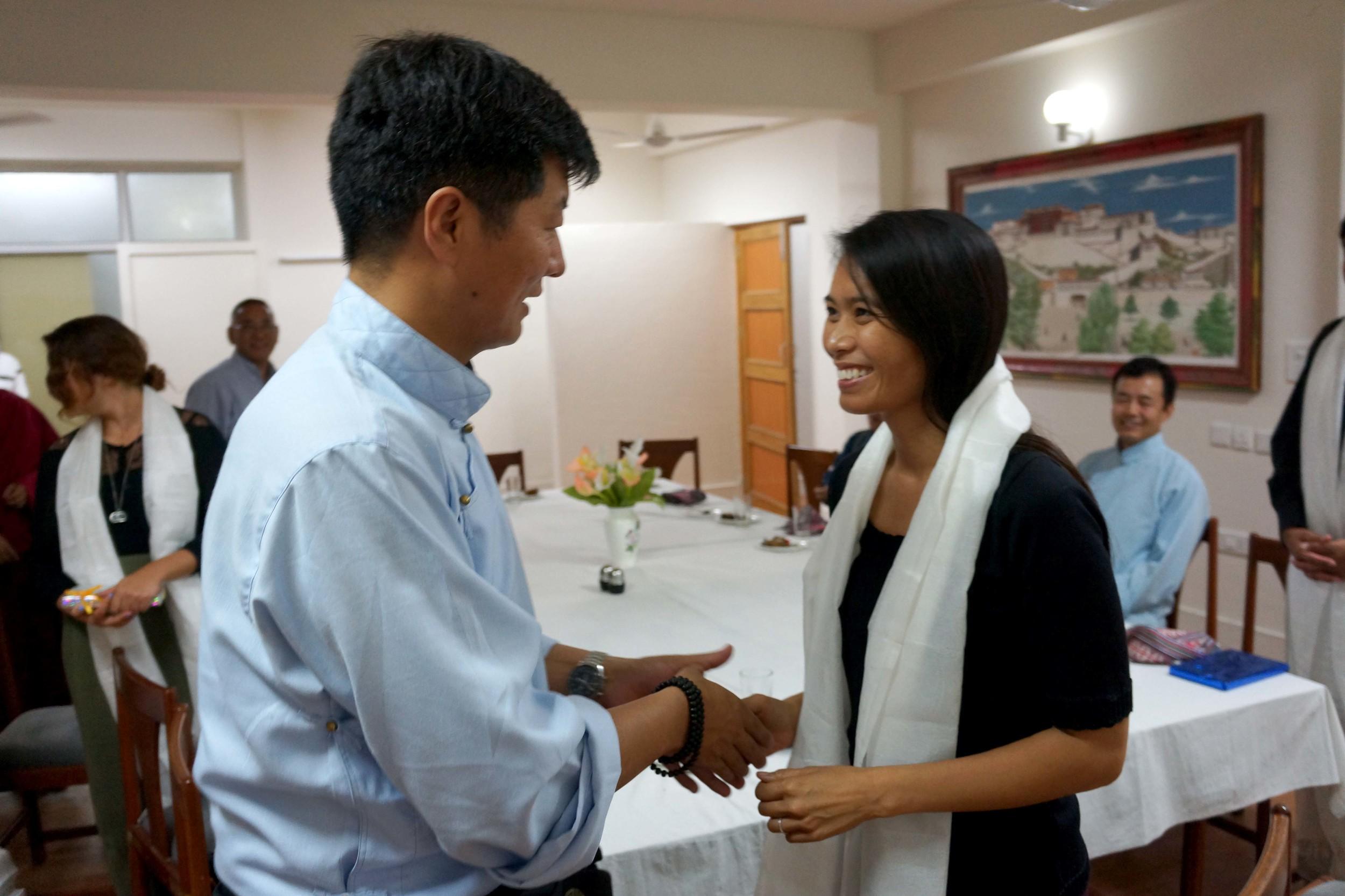 Sikyong Lobsang Sangay (left) greeting Ana Rowena McCullough (right)