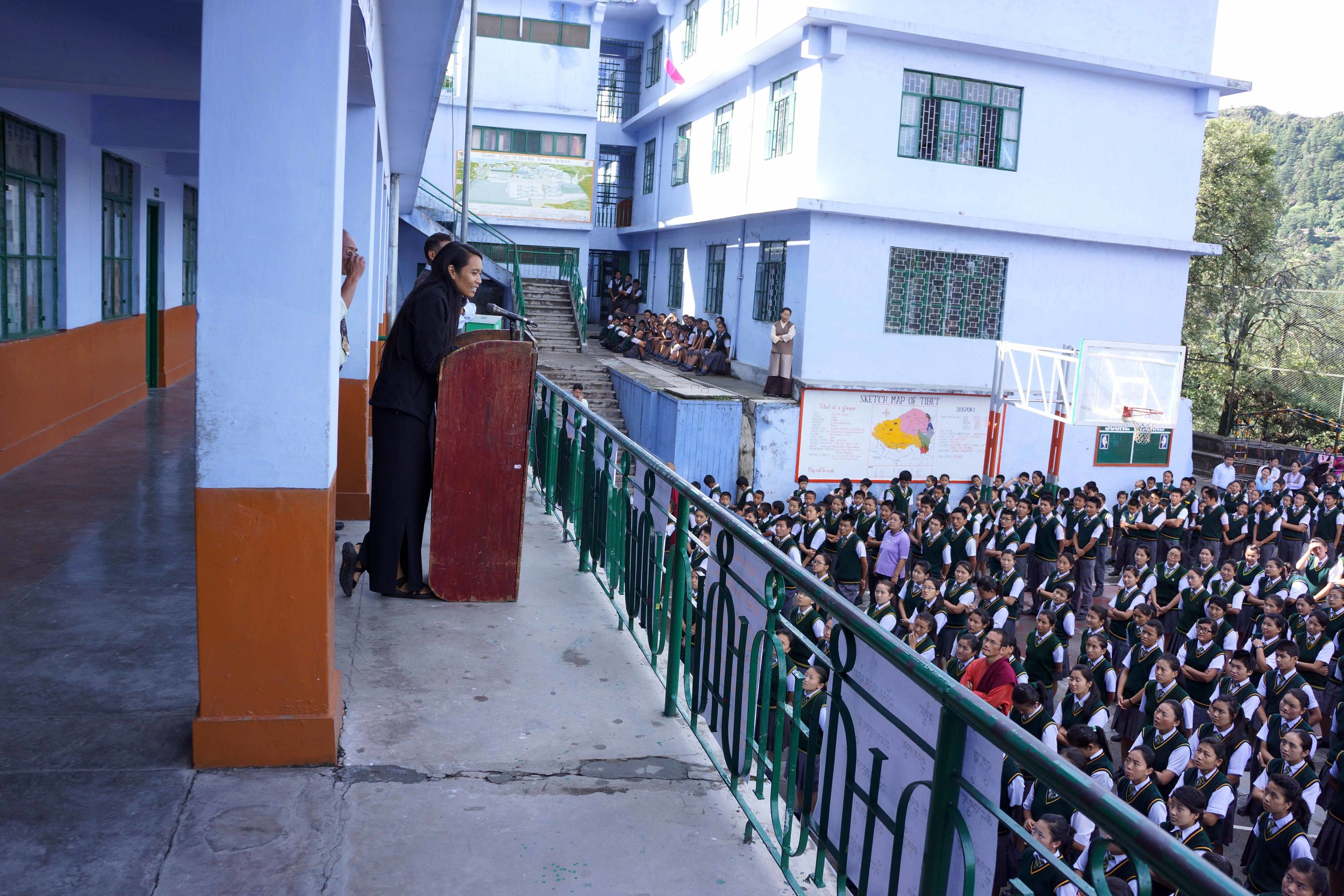 Ana Rowena McCullough giving a speech to an assembly of Tibetan students