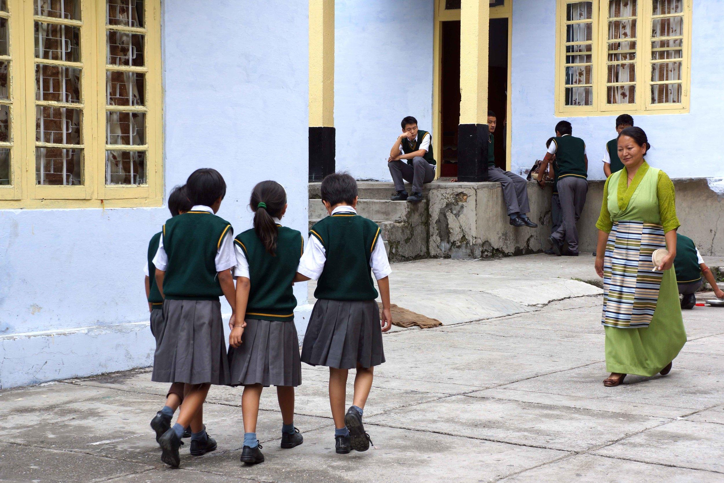 Tibetan schoolchildren walking in a group