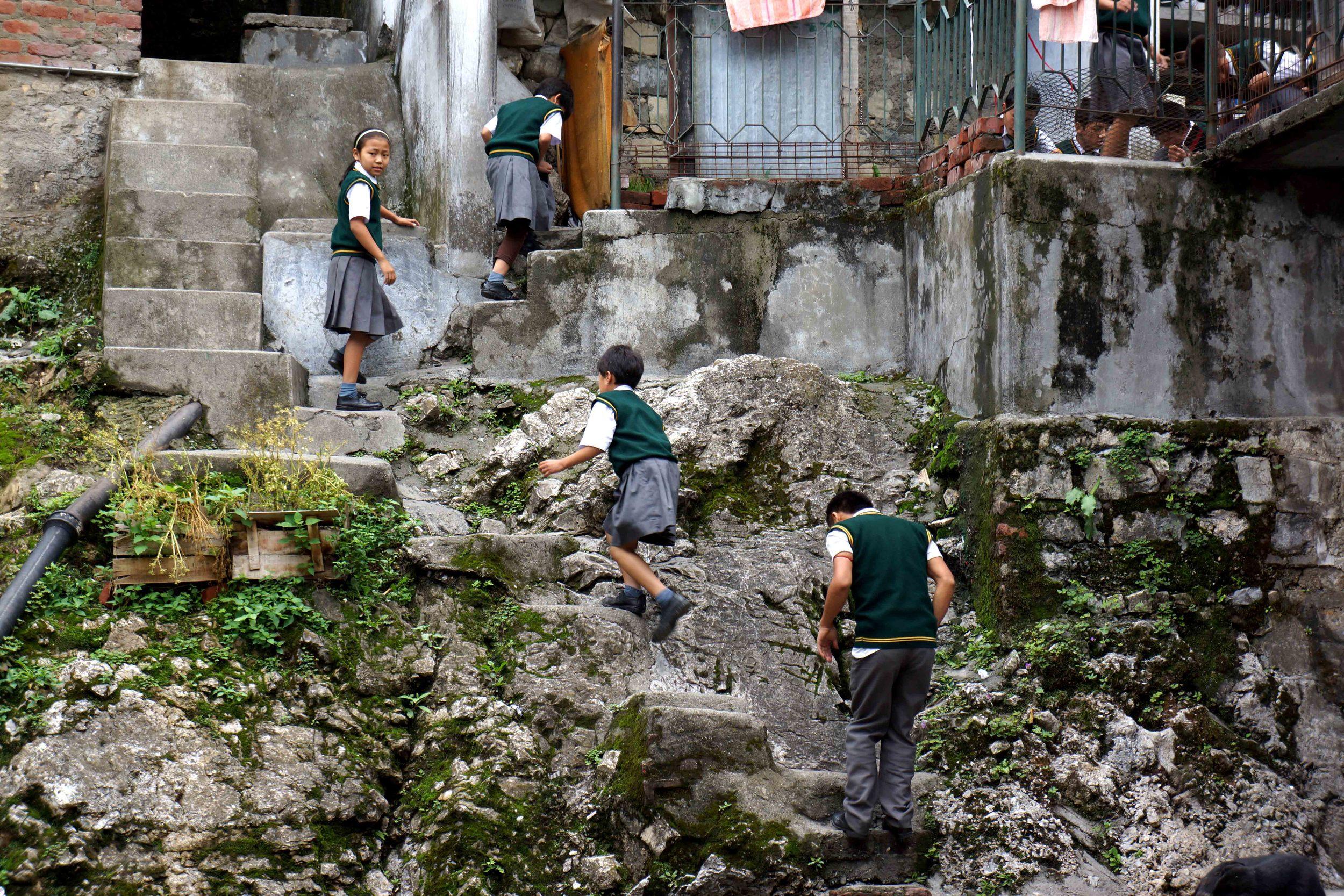 Image of Tibetan schoolchildren climbing stairs
