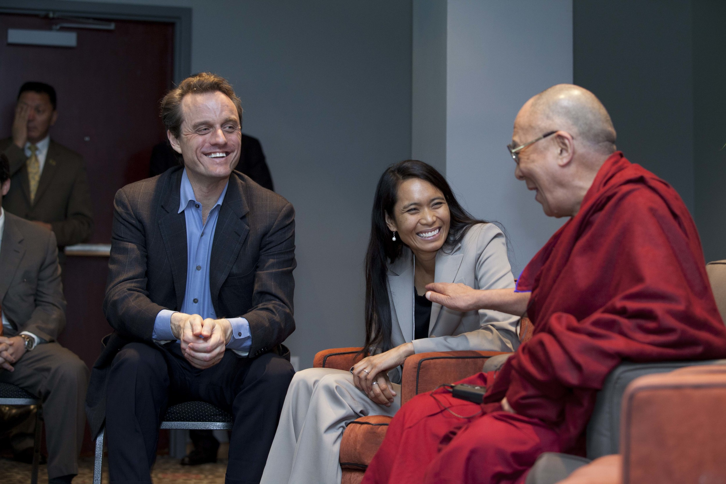 Image of Dr. Michael McCullough (left), Ana Rowena McCullough (center), and His Holiness The Dalai Lama (right) sitting during a conversation