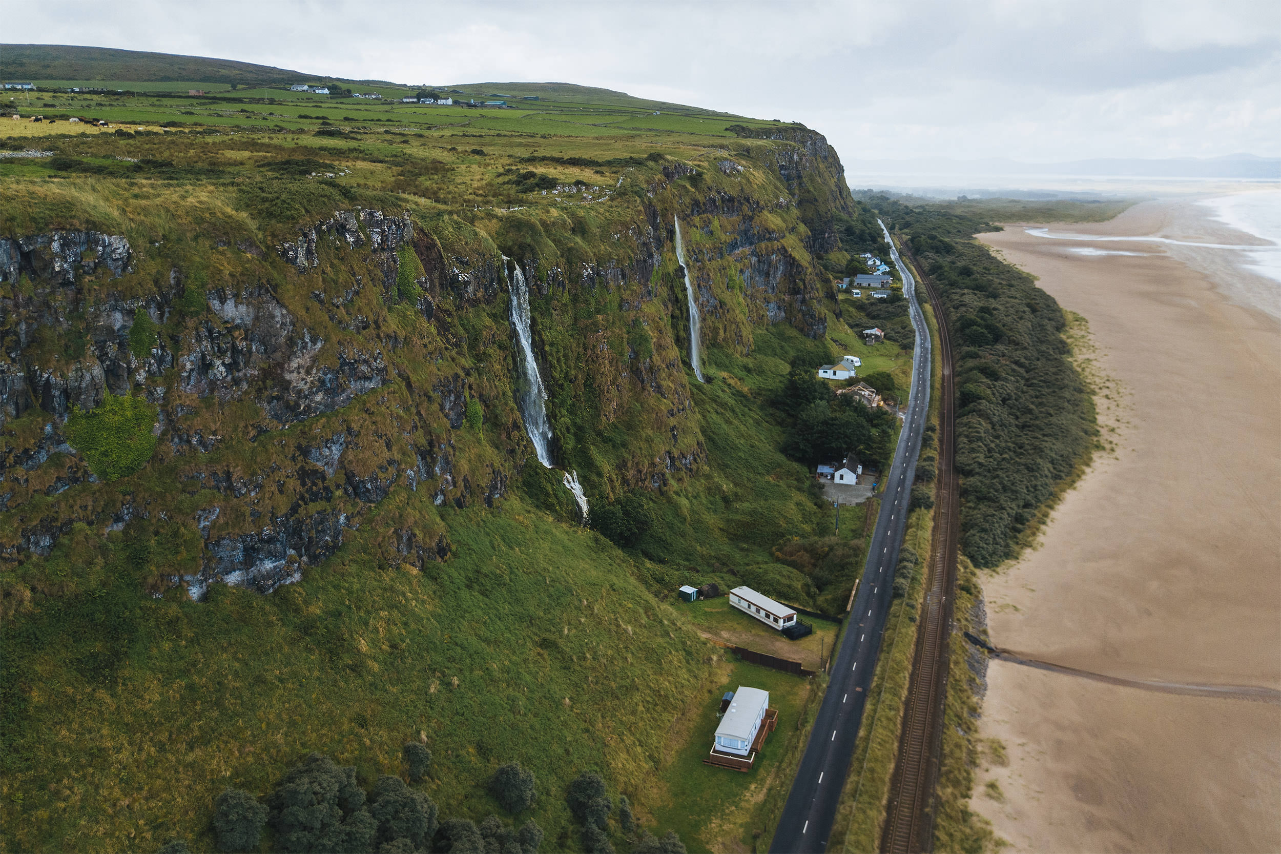 02-travel-northern-ireland-waterfall-county-antrim-benone-beach-drone.jpg