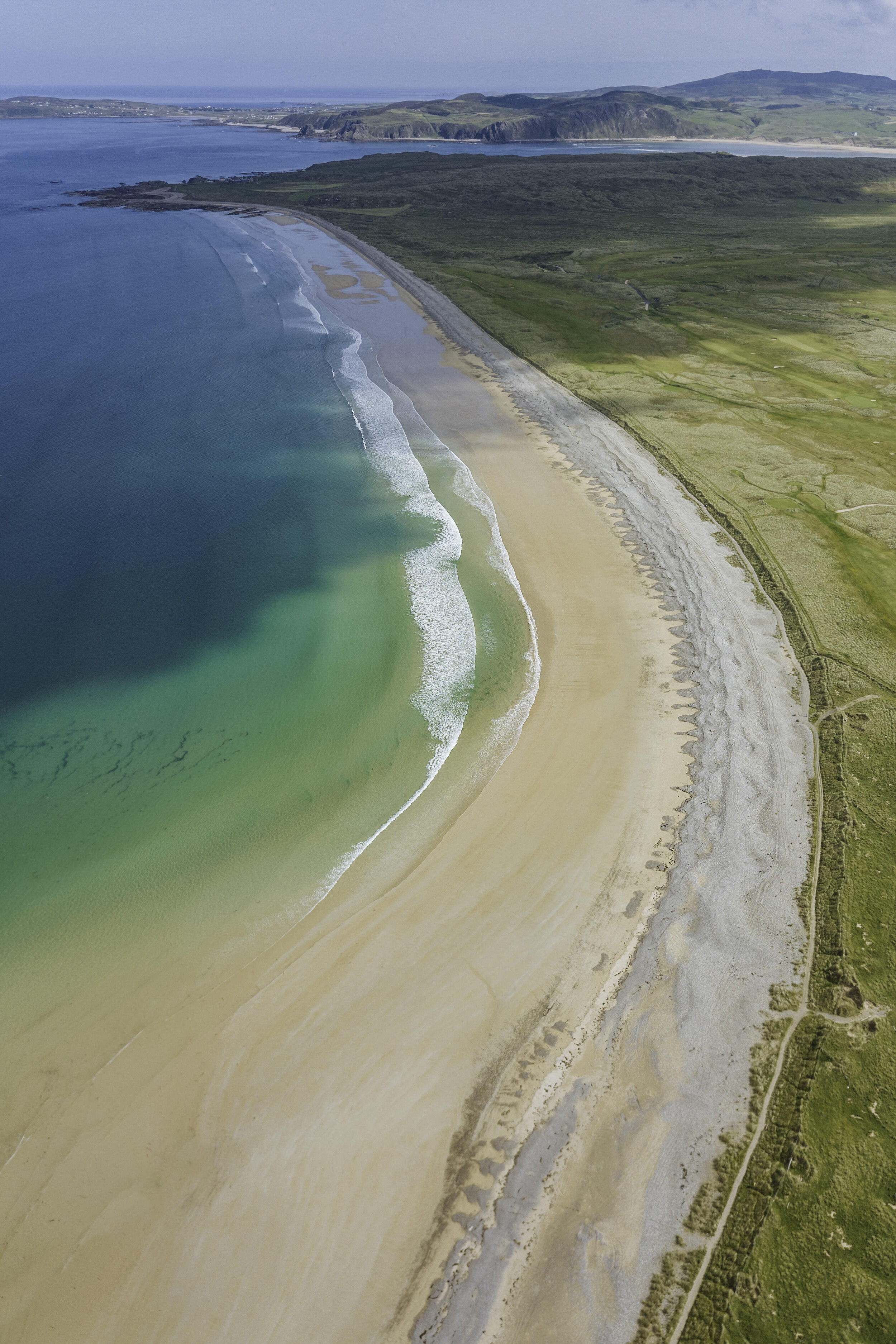 travel-ireland-inishowen-peninsula-pollan-beach-sea.jpg