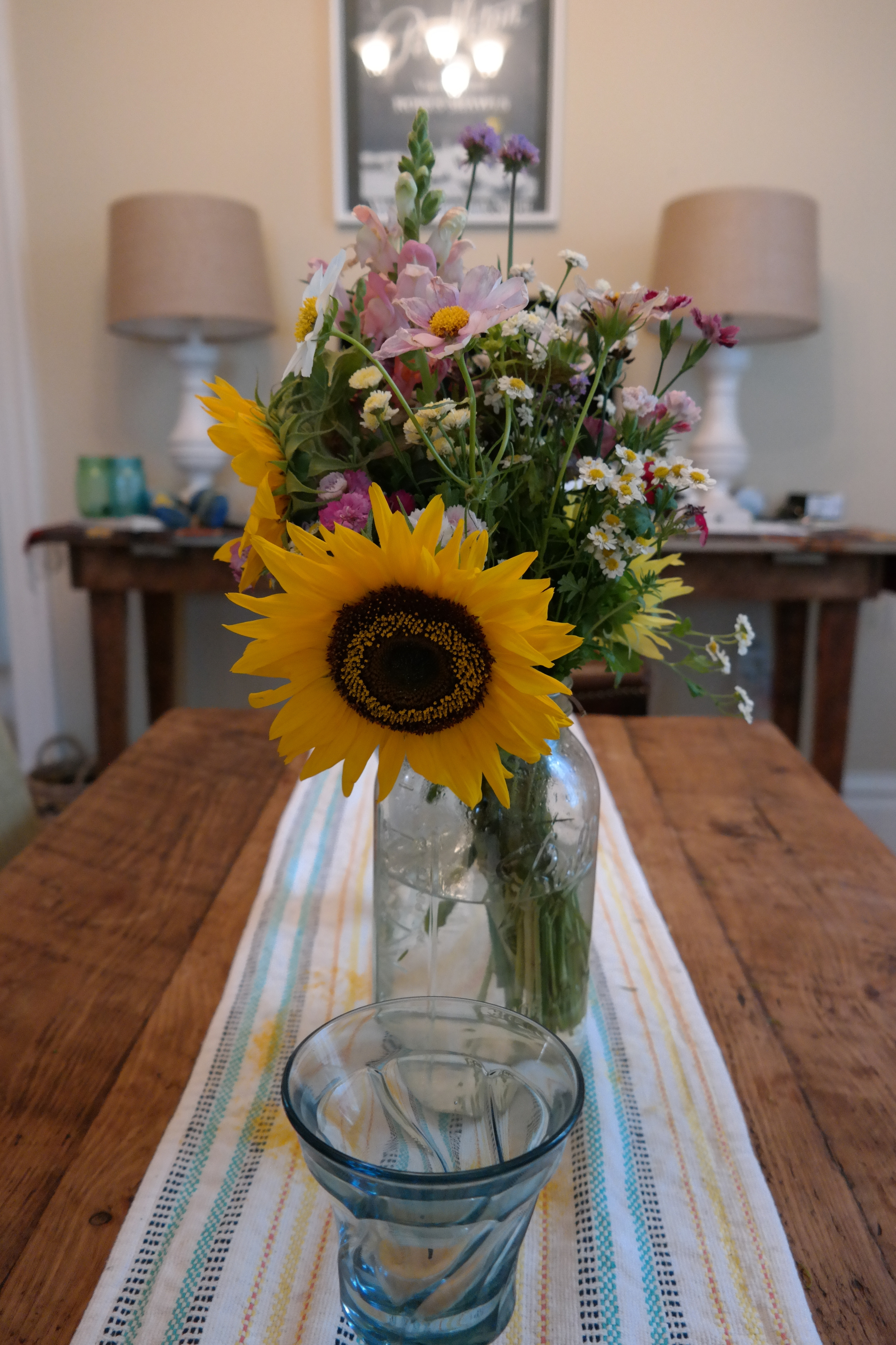 I like to mix it up with fresh, local flowers from the farmer's market, but I do prefer living plants