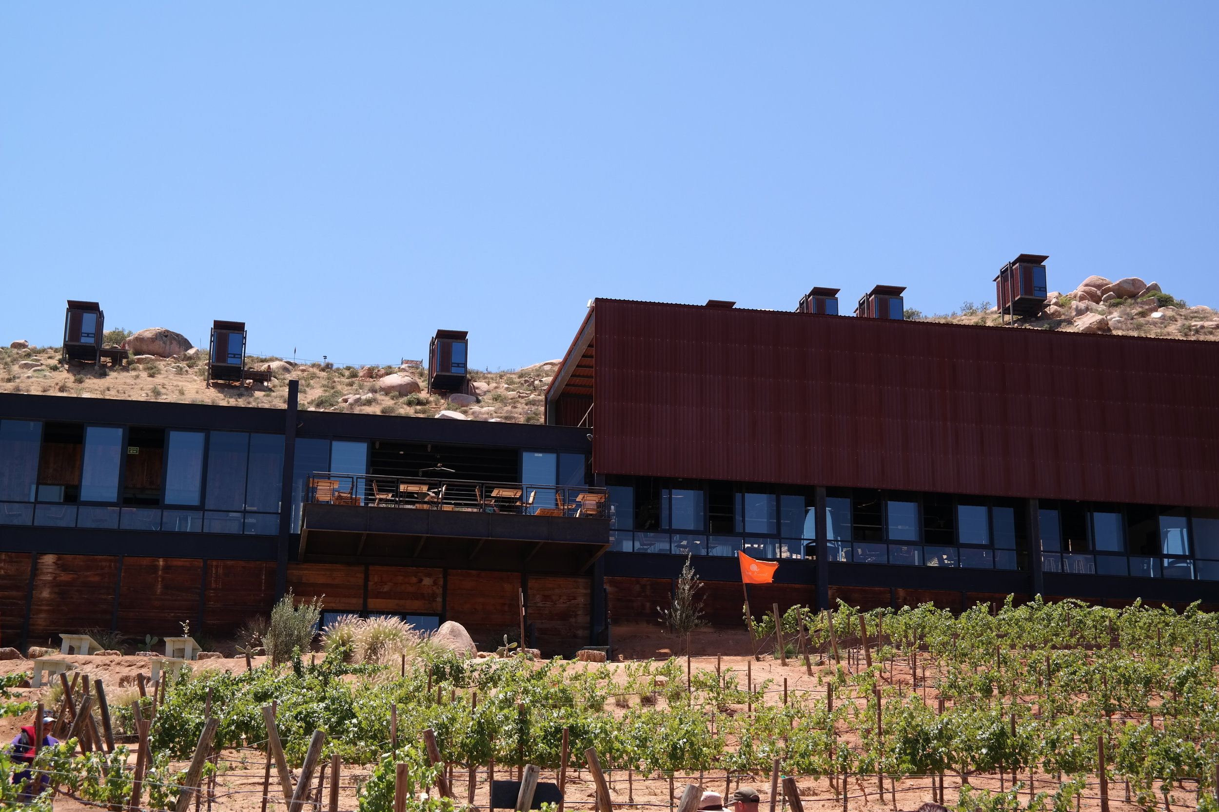 Encuentro Guadalupe winery, restaurant, and eco villas above