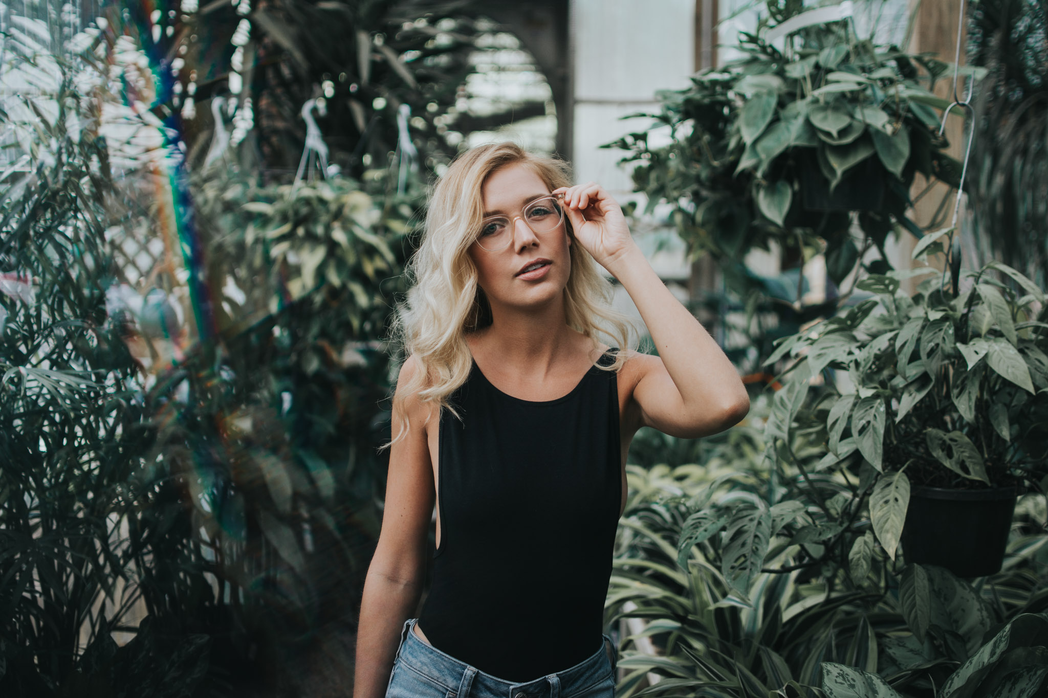 A portrait of Amanda in a greenhouse
