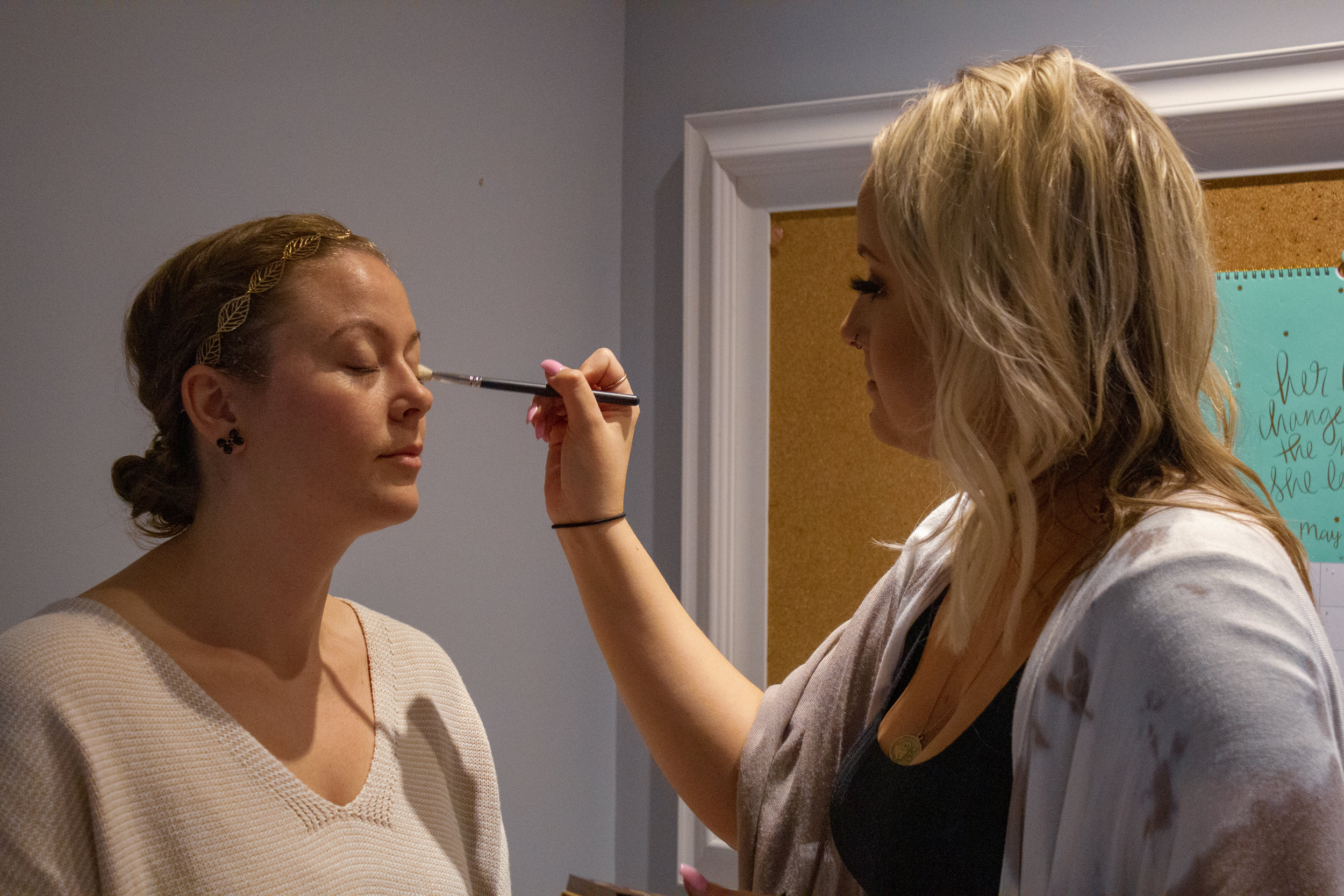 Megan Fletcher getting a touch-up from Samantha Jane Beauty
