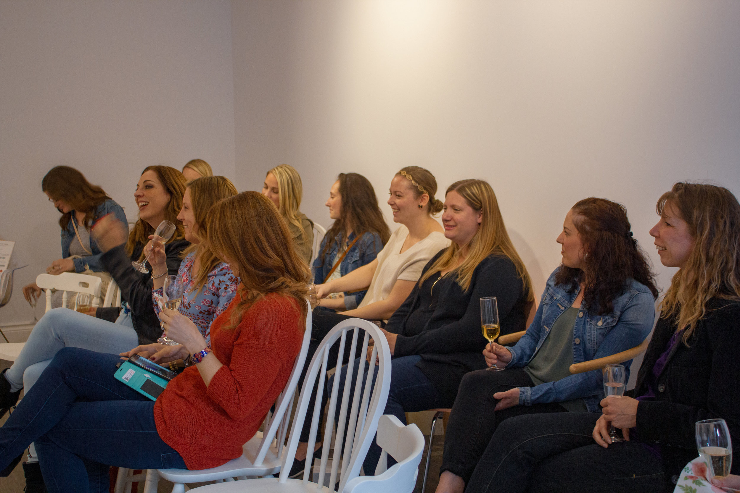 Some ladies listening to Mavis during her style workshop