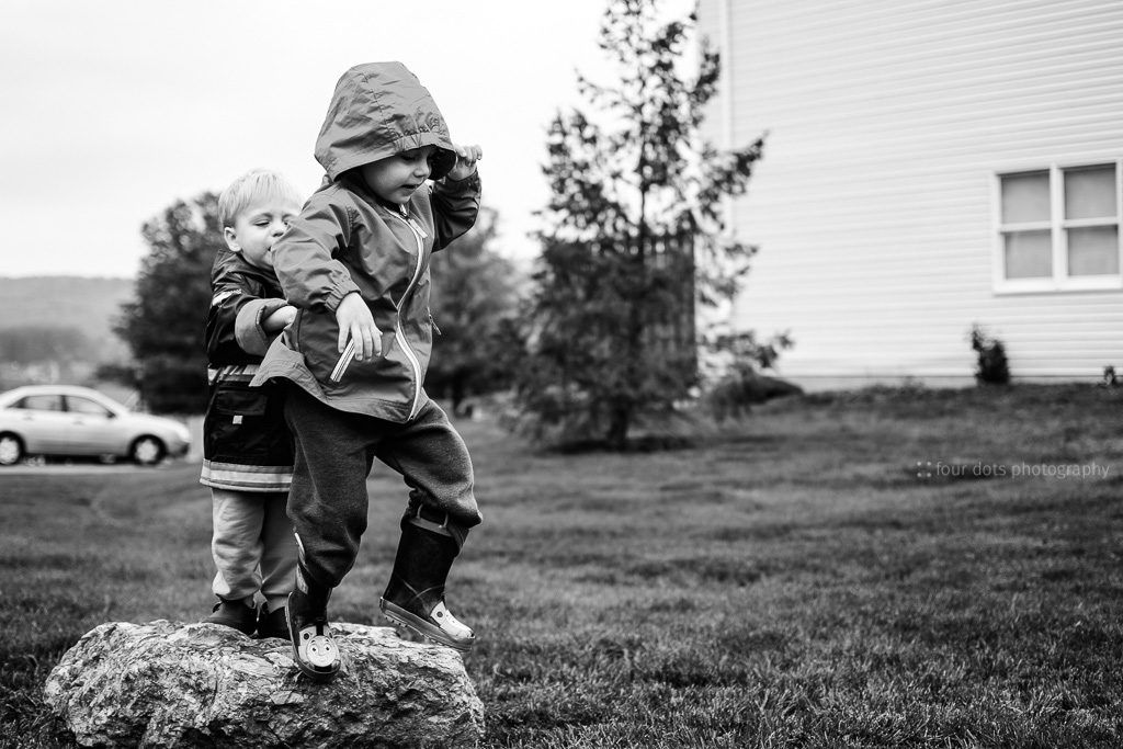 we found this great rock on a walk around our neighborhood.  they immediately set to jumping (or pushing each other) off of it.  after that it wasn't so great anymore ;)
