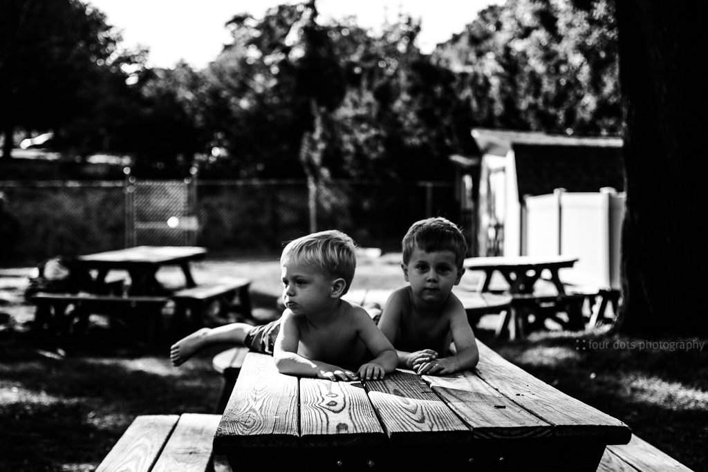 "at this time a year ago, i would have deleted this one without a second glance because the focus fell on the table in front of them and not on their sweet faces.  but a year is a long time for learning and growing, and so now i say ""forget you, rules"".  i adore this image.  everything about it.  so it will stay, and i will love it."
