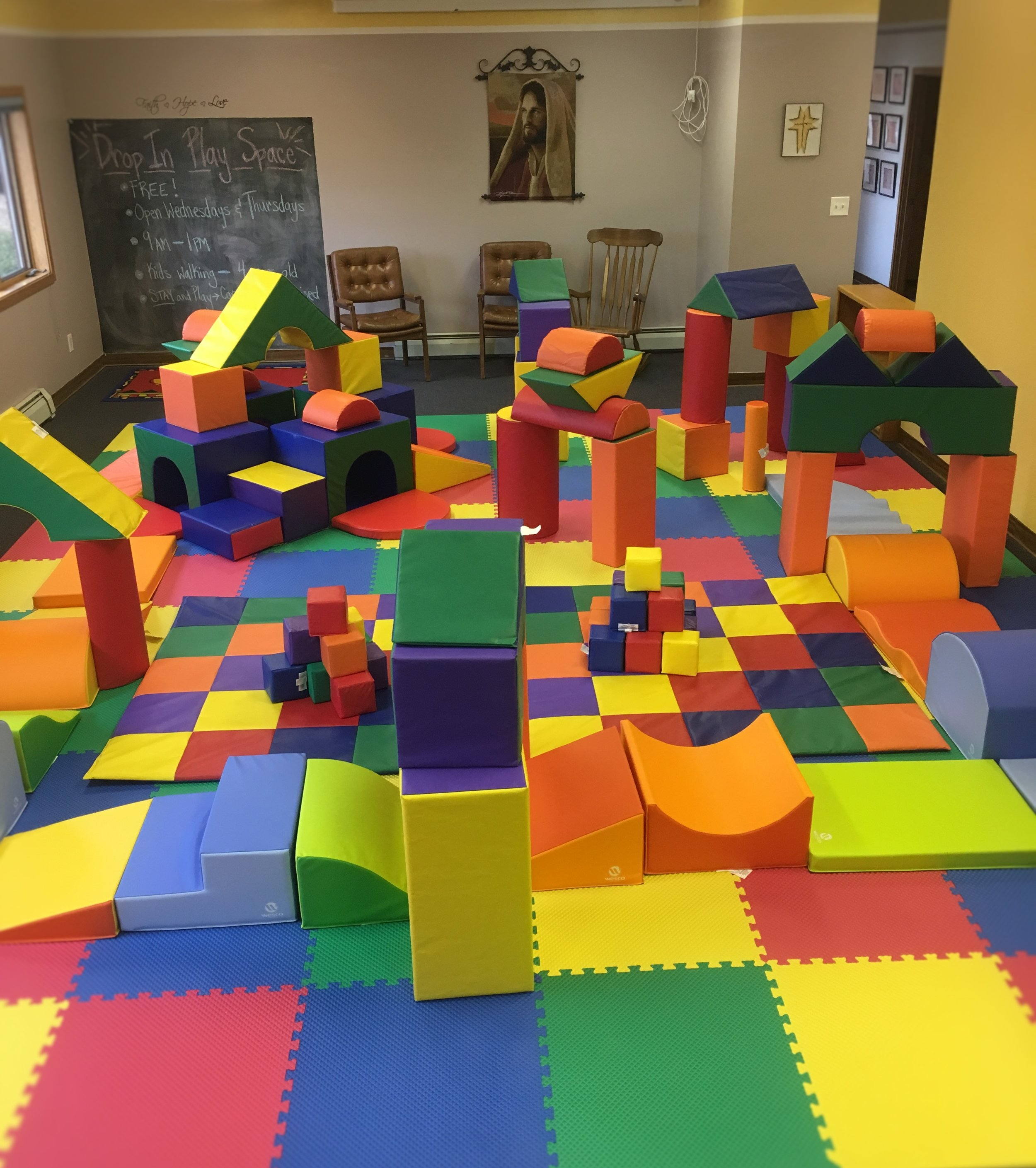 Open Wednesdays and Thursdays 9am-12pm - :: Ages Walking- 4:: Caregiver supervised: Stay and Play:: Socks must be worn by both adults and children on equipment:: Free and open to the community