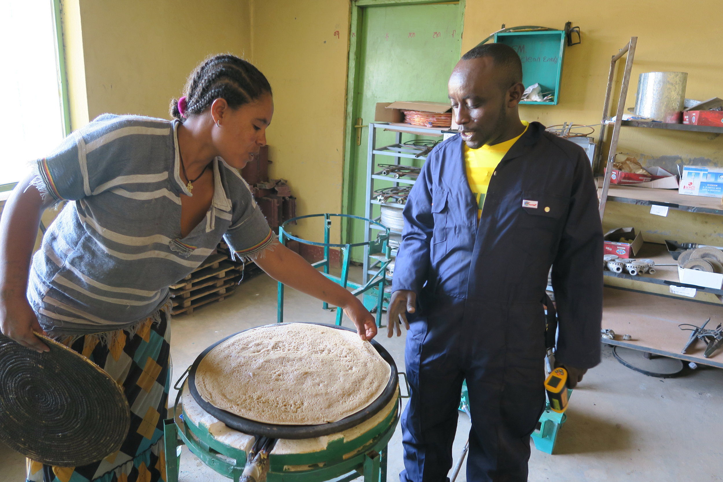 USADF partner GM Clean Energy and Fuel Efficient Technology Developer and Disseminator PLC, demonstrate their biogas-baked  injera
