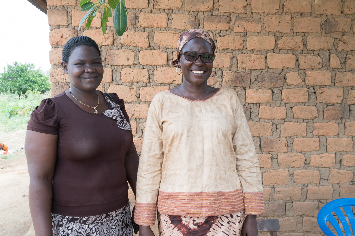 Agnes Atim Apea (right) formed a business minded rice cooperative to help women earn incomes and feed their families. Photo credit: Julia Tanton