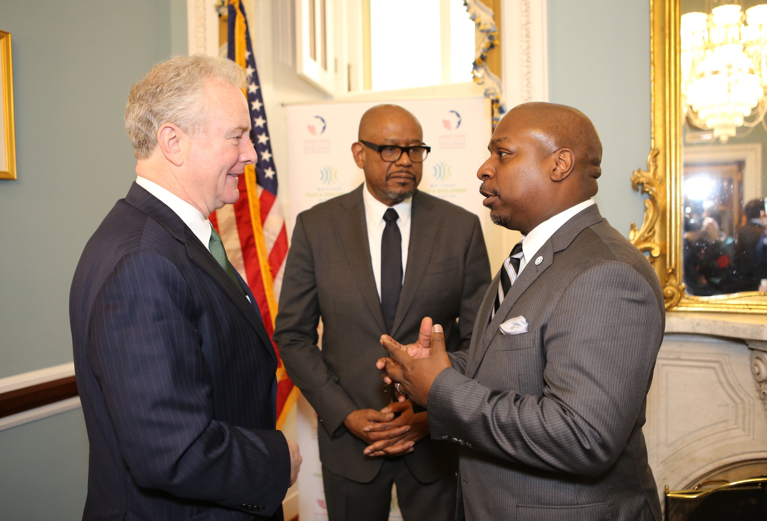 Senator Chris Van Hollen (left) was one of several members of Congress who joined WPDI Founder/CEO Forest Whitaker and USADF President/CEO C.D. Glin for the partnership announcement.