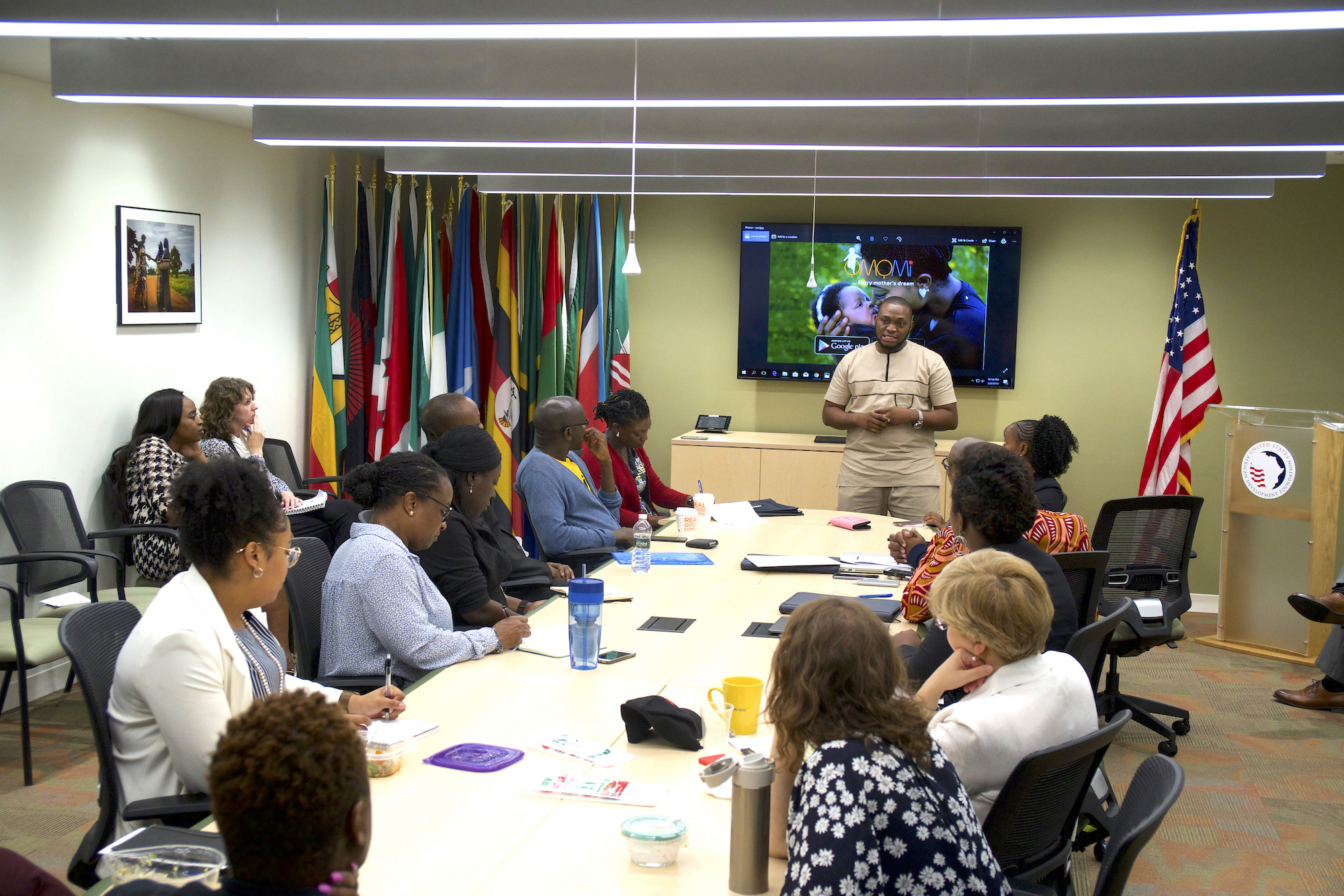 "YALI Fellow Charles Akhimien delivered his ""elevator pitch"" about MOBicure and his new apps to USADF staff, while other fellows observed."
