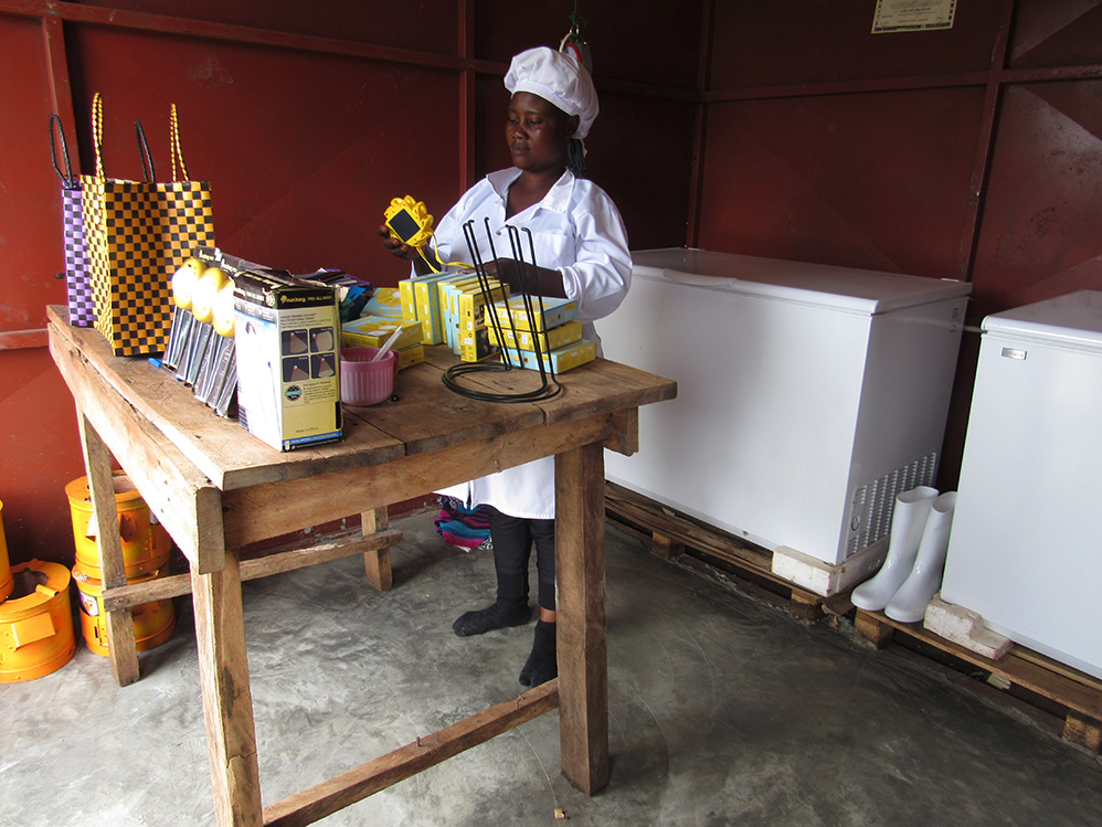 Women in Uganda's Kalangala District now have access to solar-powered refrigeration and other green energy products to support their businesses and their work in the local fish-processing industry.