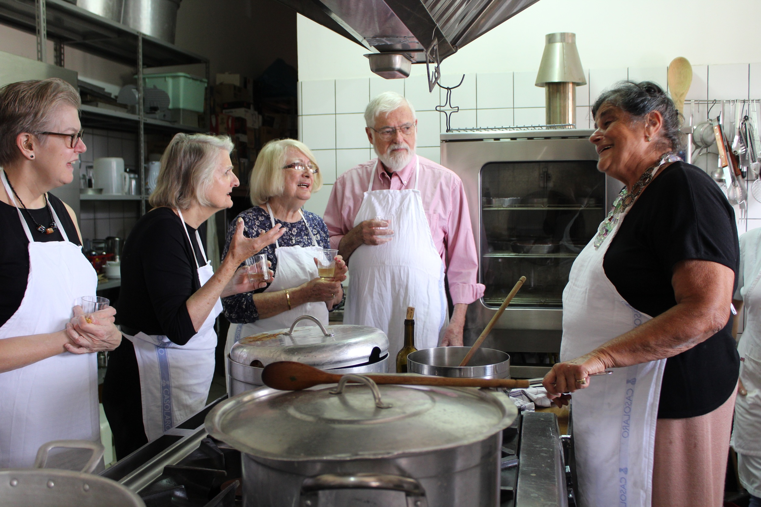 Baronessa Cecilia Baratta Belleli teaches cooking class guests how to make ragú in her farmhouse kitchen in Paestum.