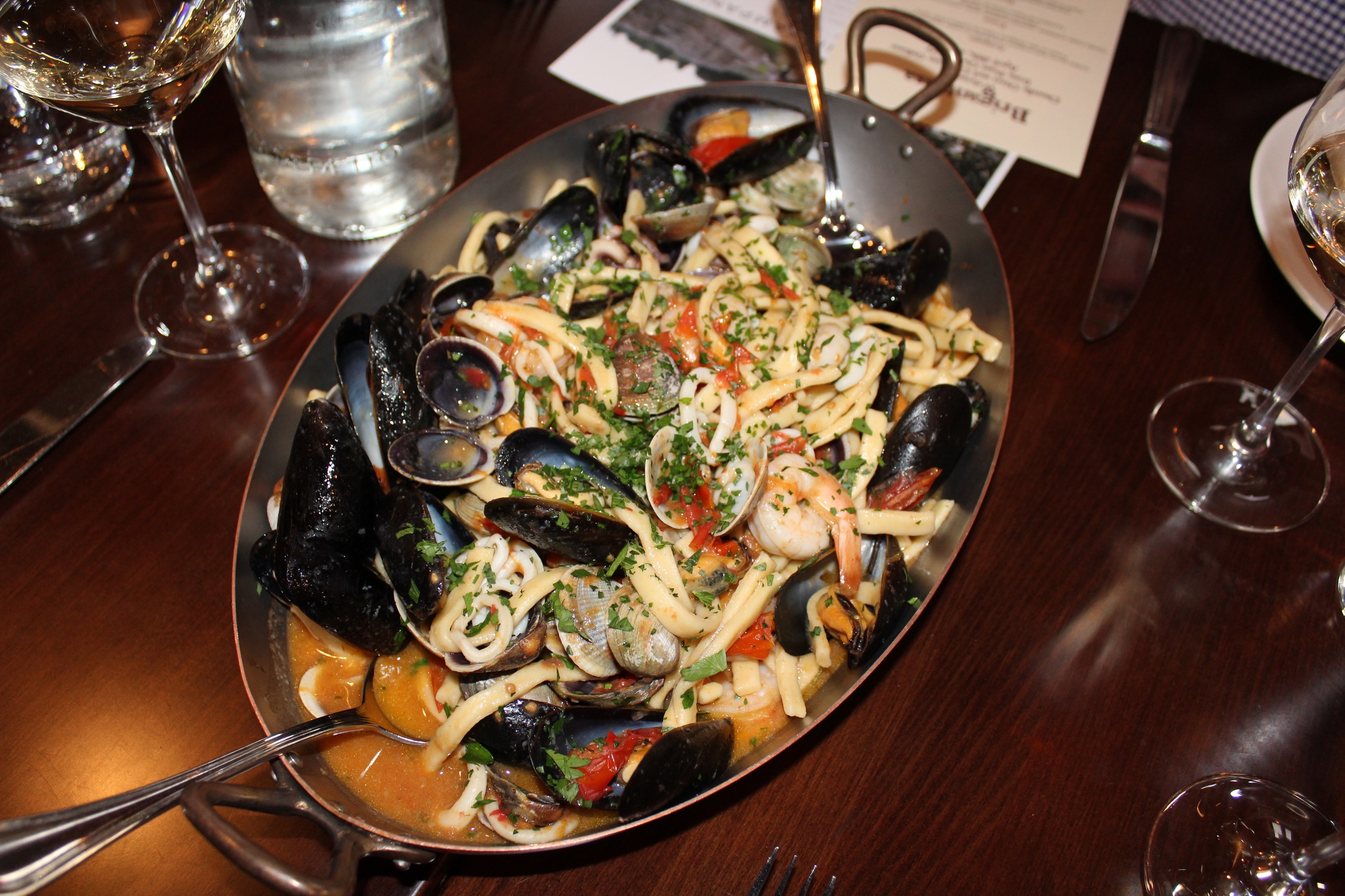 House-made scialatieli, assorted seafood, garlic, peperoncini, white wine, Piennolo tomatoes, parsley