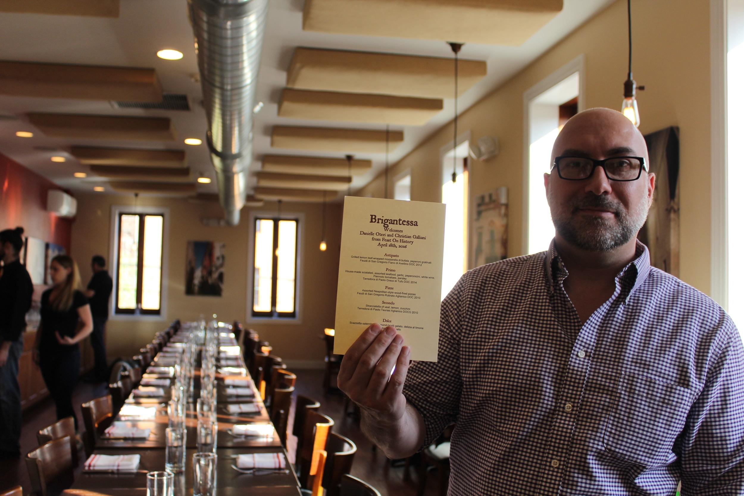 Christian Galliani holds the menu for our Campania wine dinner at Brigantessa in Philadelphia