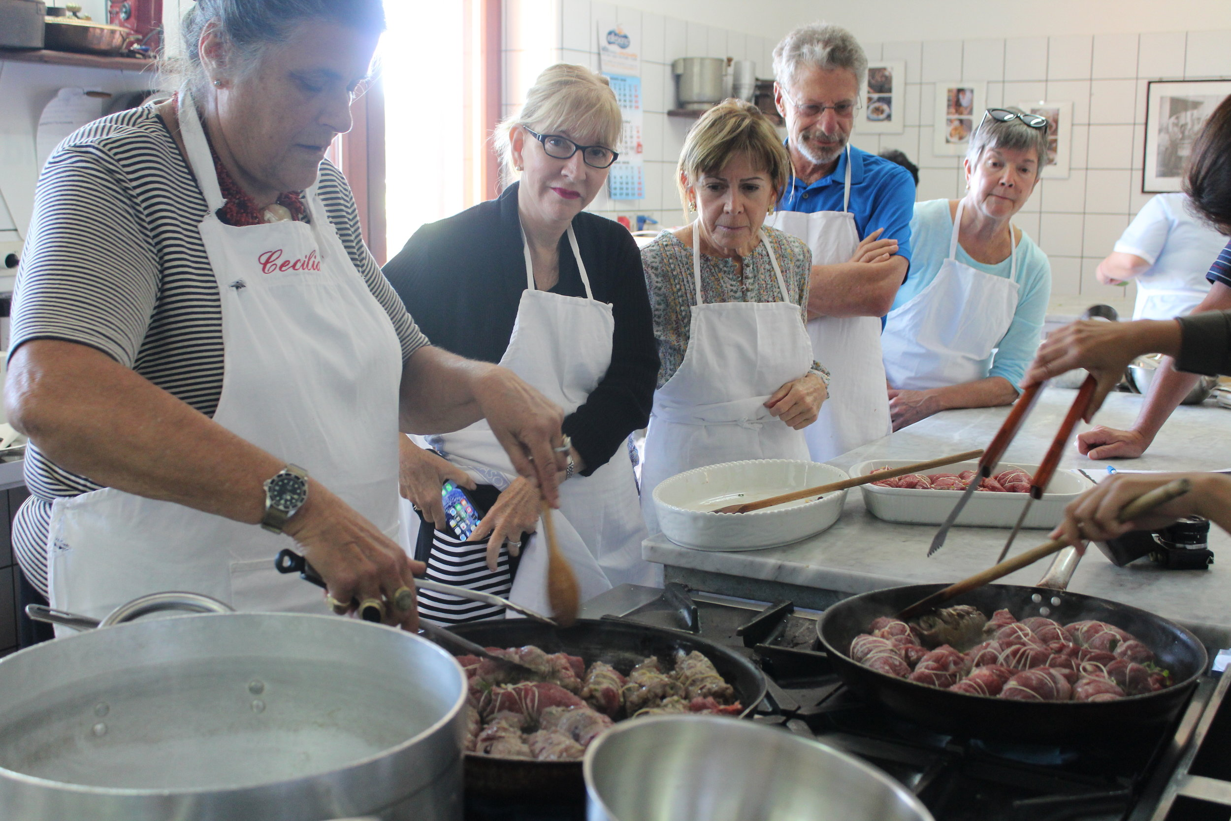 The Baronessa teaches guests how to brown bracciole