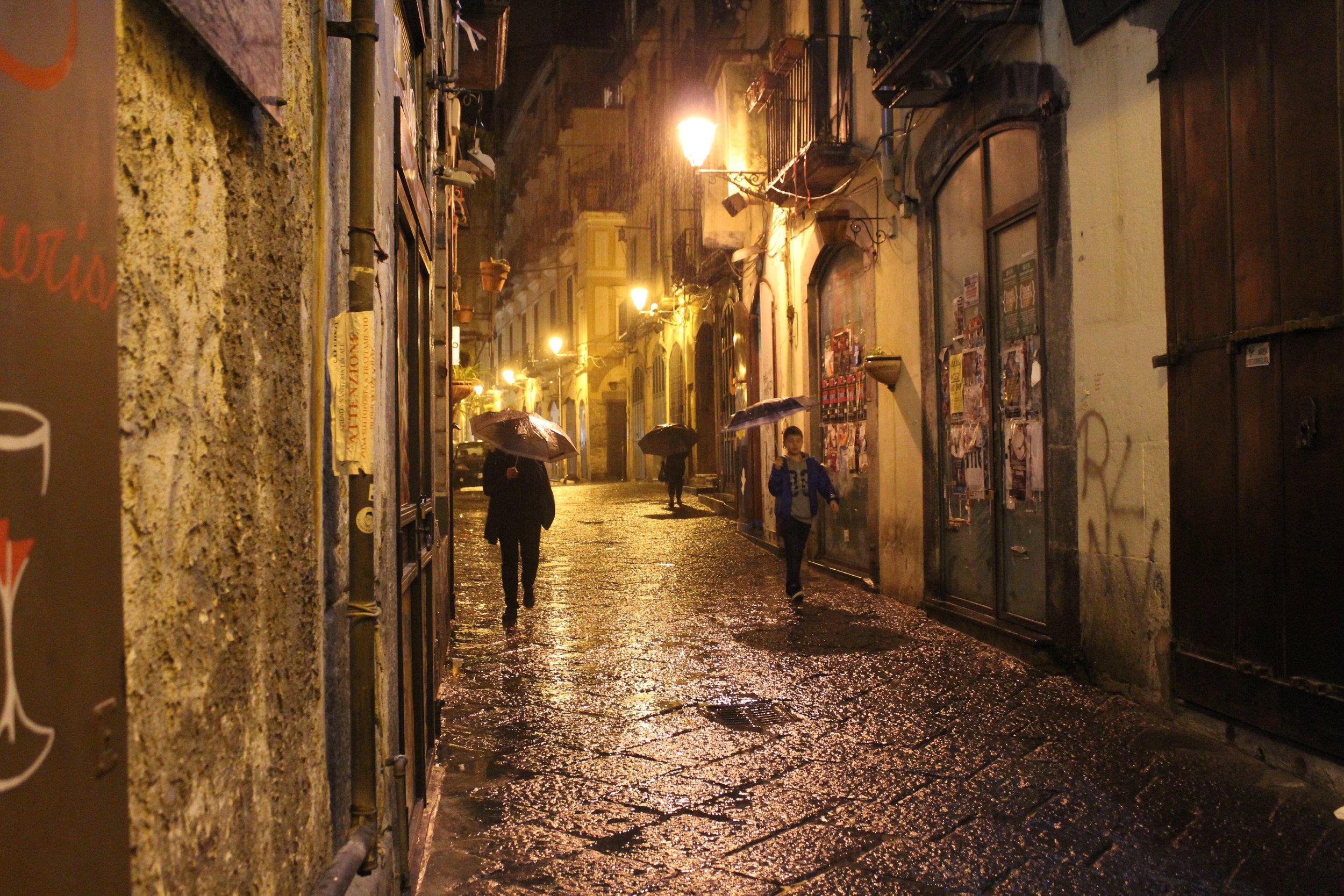 Salerno's historic center on a rainy night.