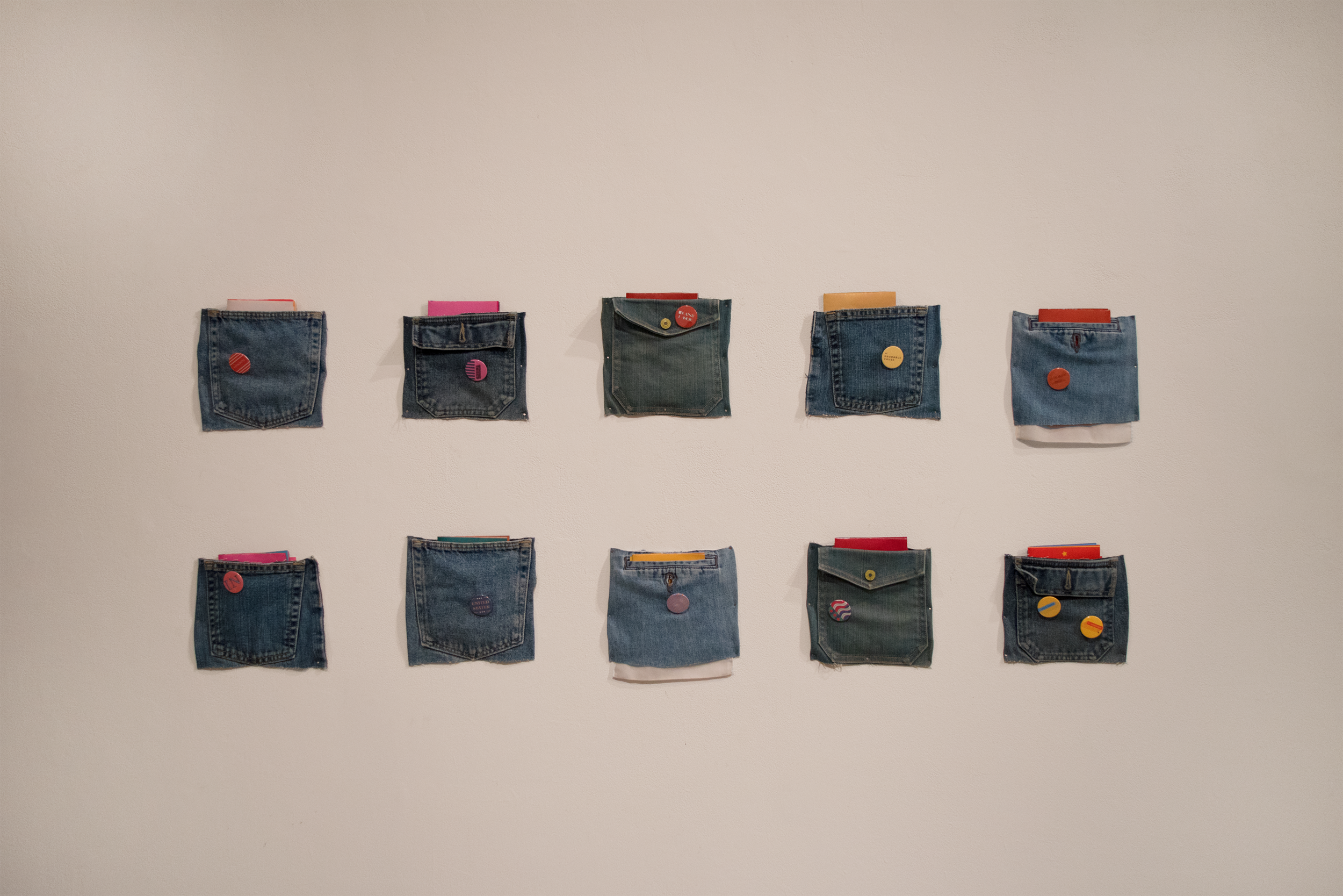 The zines were displayed in denim pockets, a nod to a quintessential United States fashion garment.