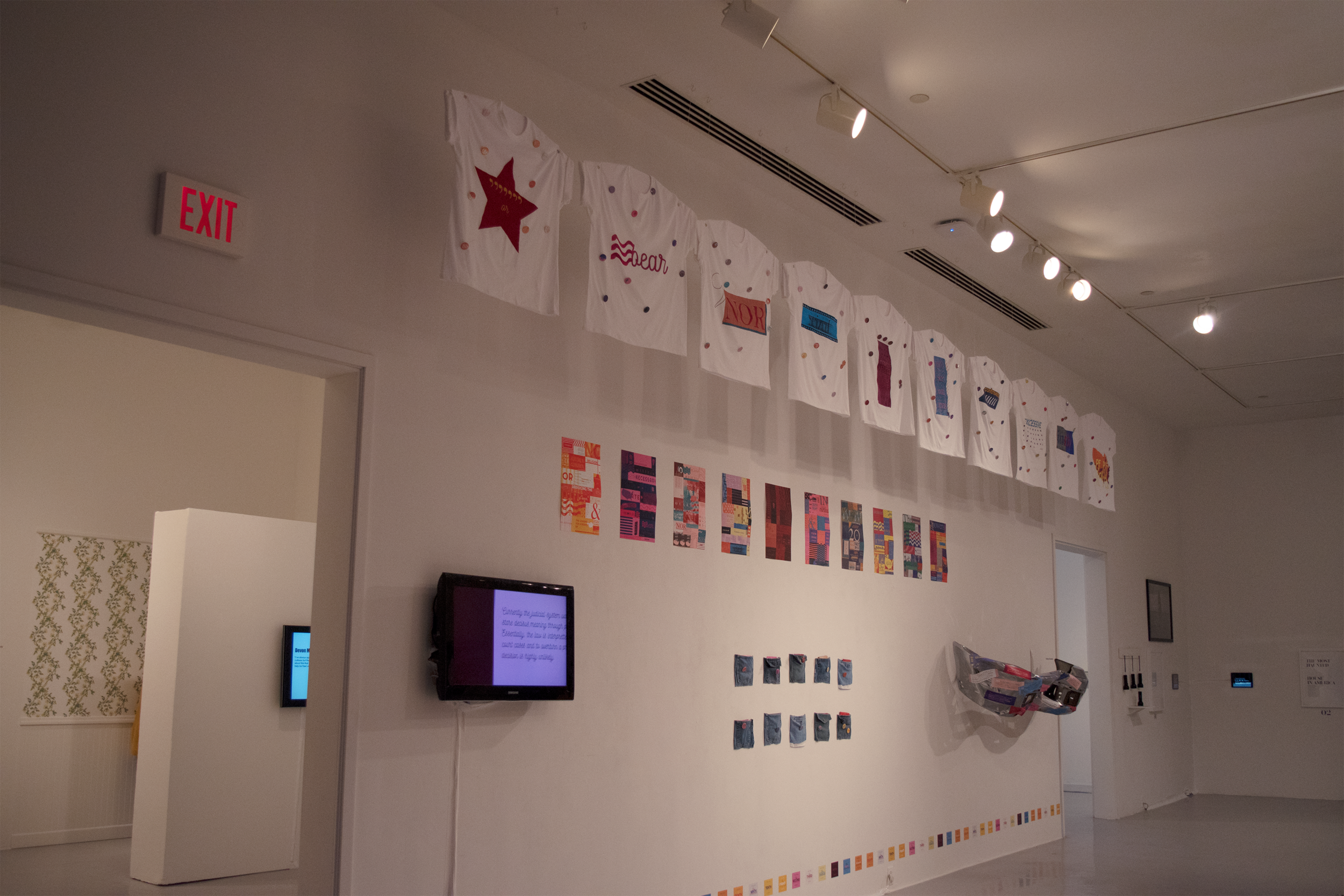 The installation included posters, t-shirts, pins, stickers, zines, and a video.