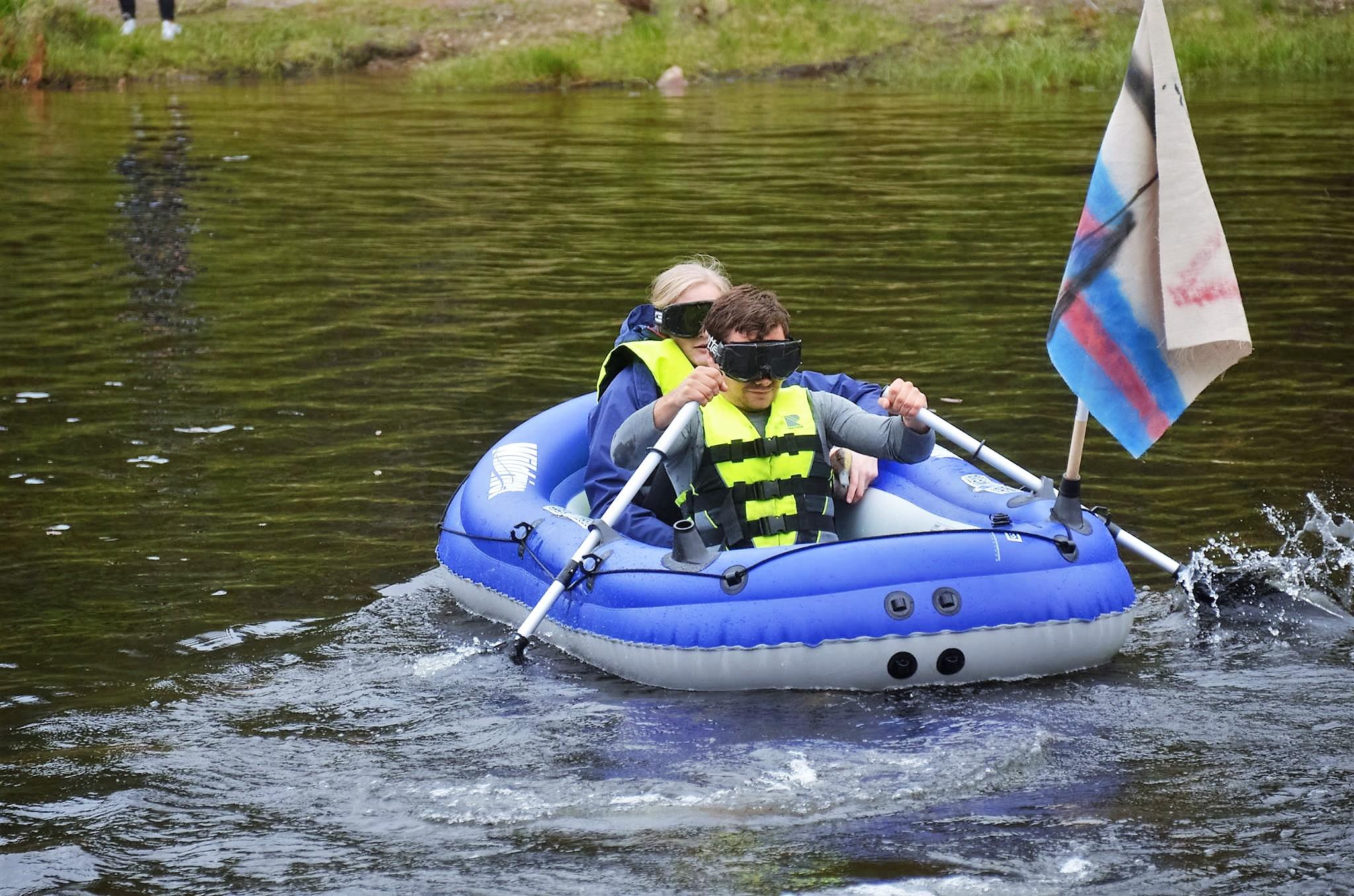 Rowing blindfolded.
