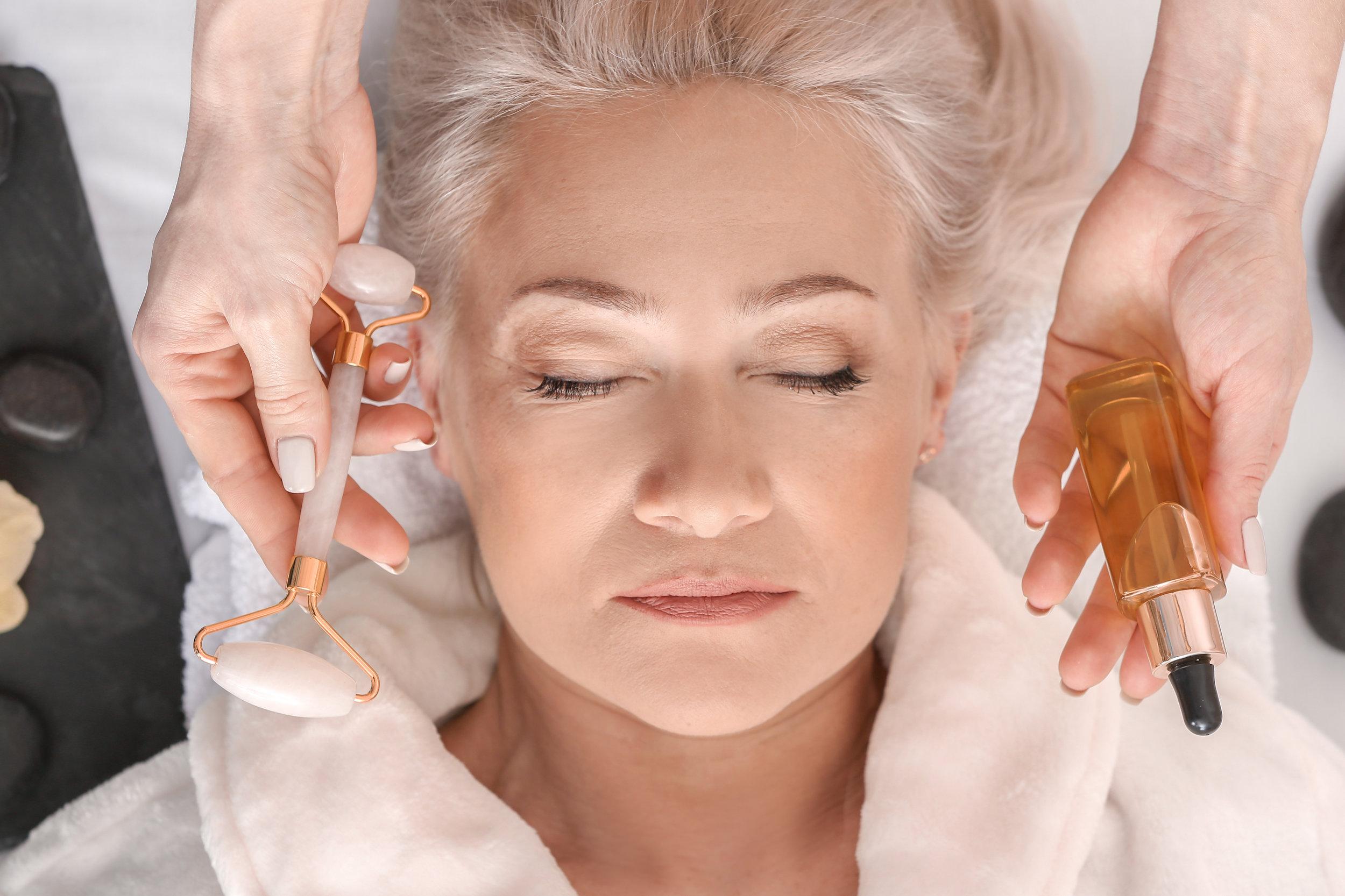 Mature woman undergoing treatment in beauty salon