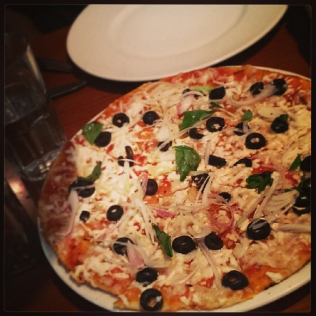 Goat cheese pizza with scallions and olives