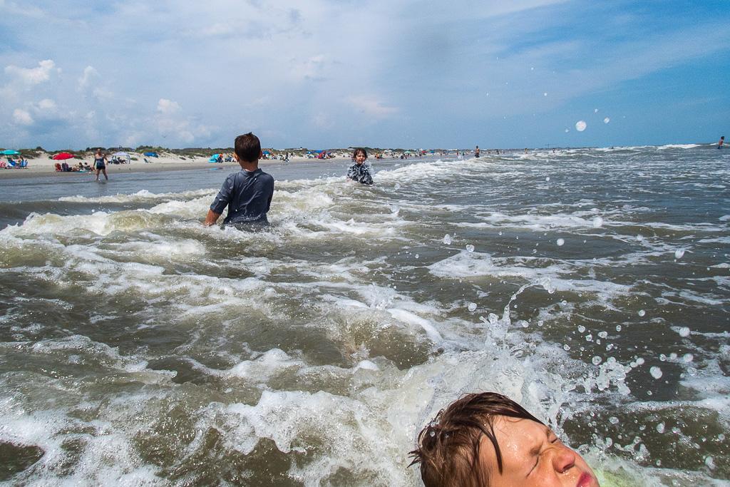 brothers-swim-ocean-waves.jpg