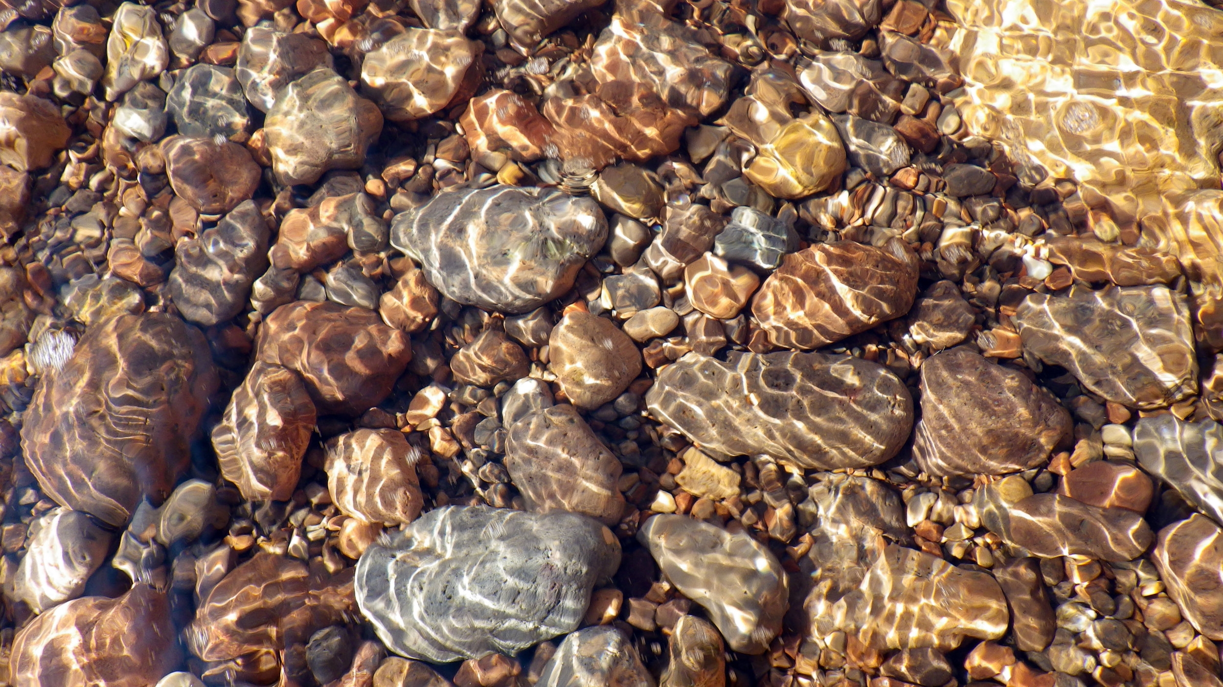 Colourful pebbles and caustics