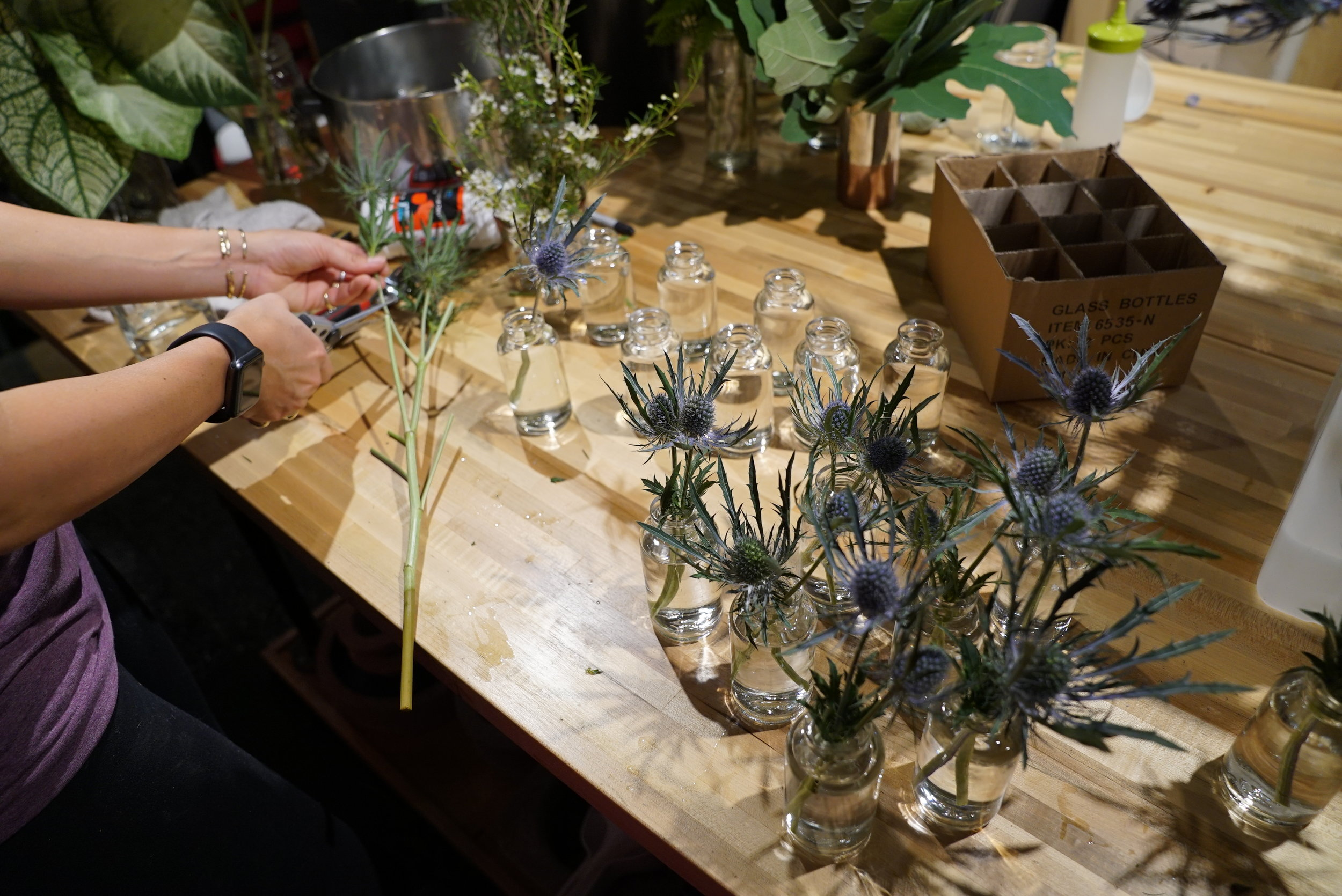 Prepping lots, and lots, and lots, and lots of tiny bottles for the table decorations.