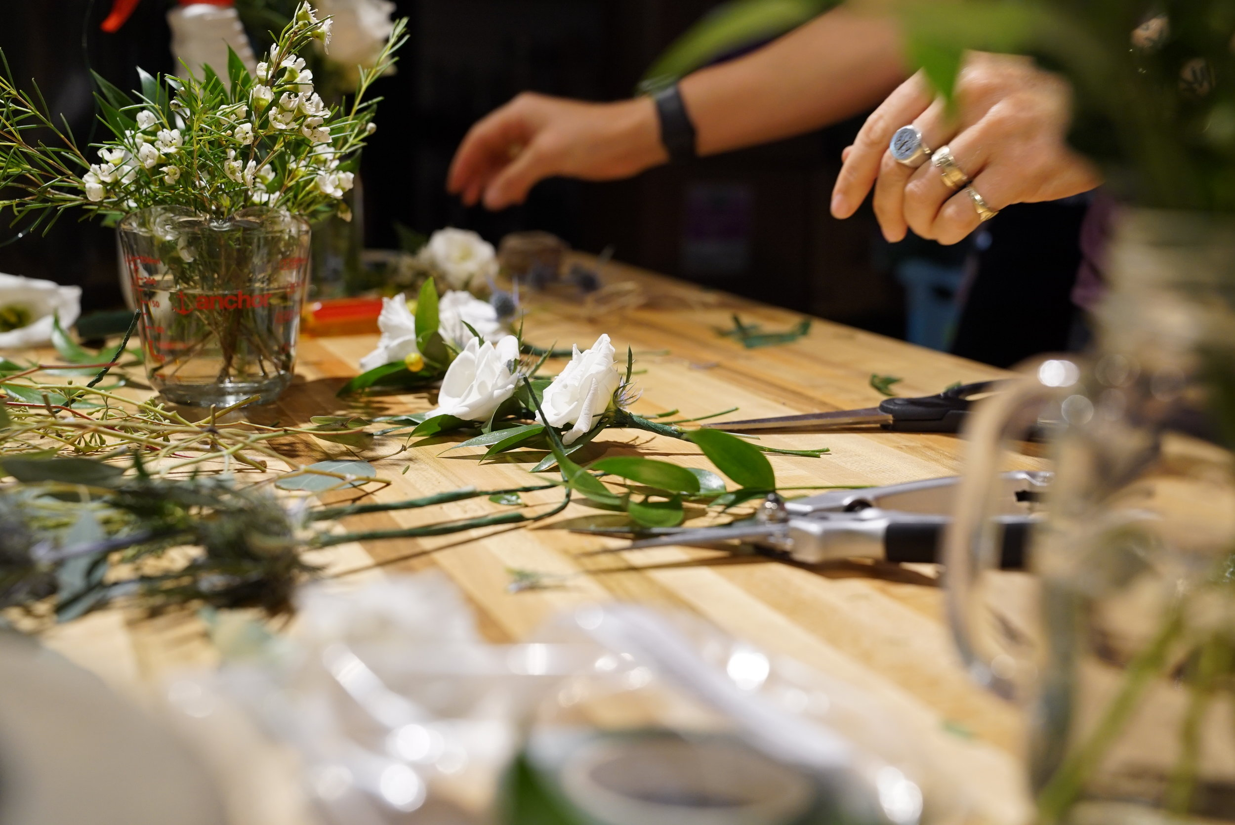 Boutonnieres are one of the last things to be assembled, as they will not have access to water once they're made. Lisianthus, while incredibly delicate looking, are actually a great choice for a long lasting boutonniere.