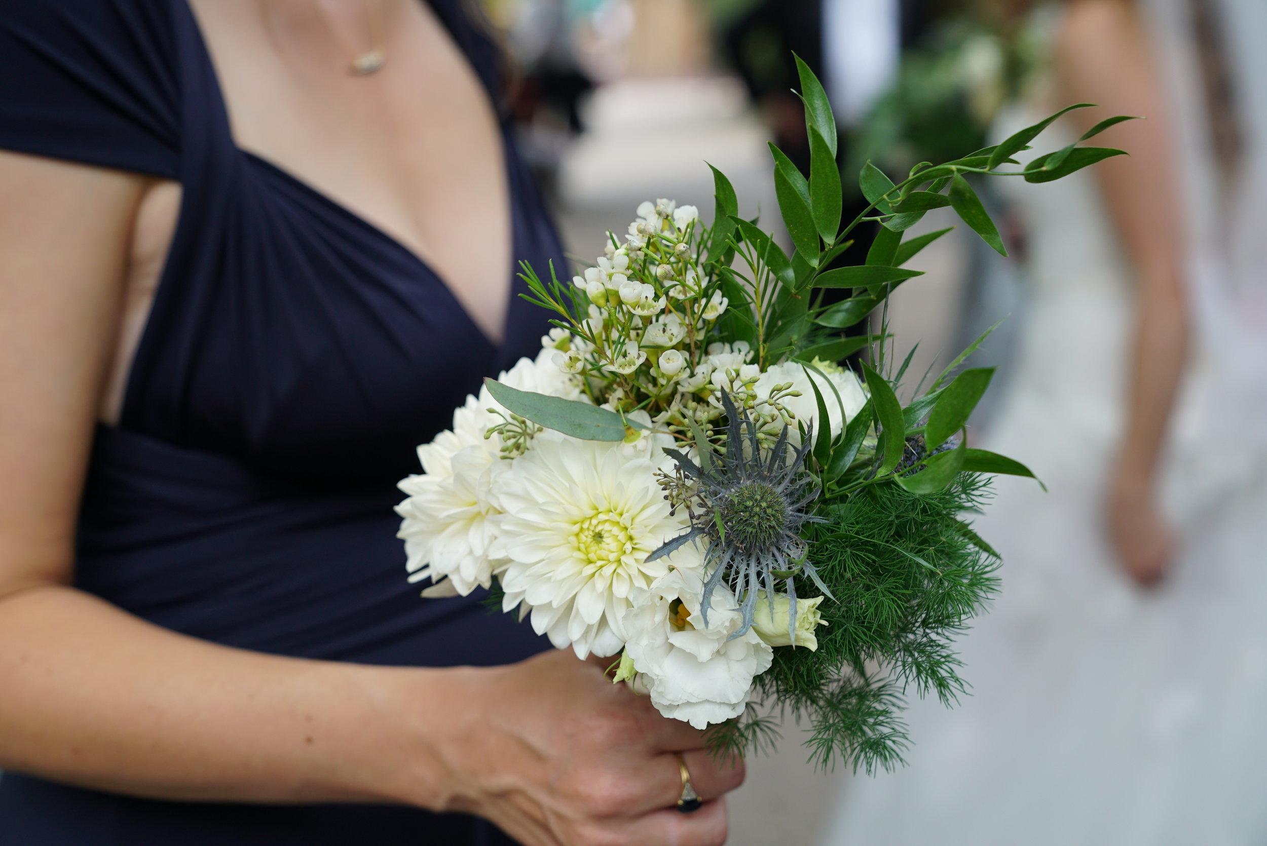 Bridesmaids bouquets were smaller versions of the brides.