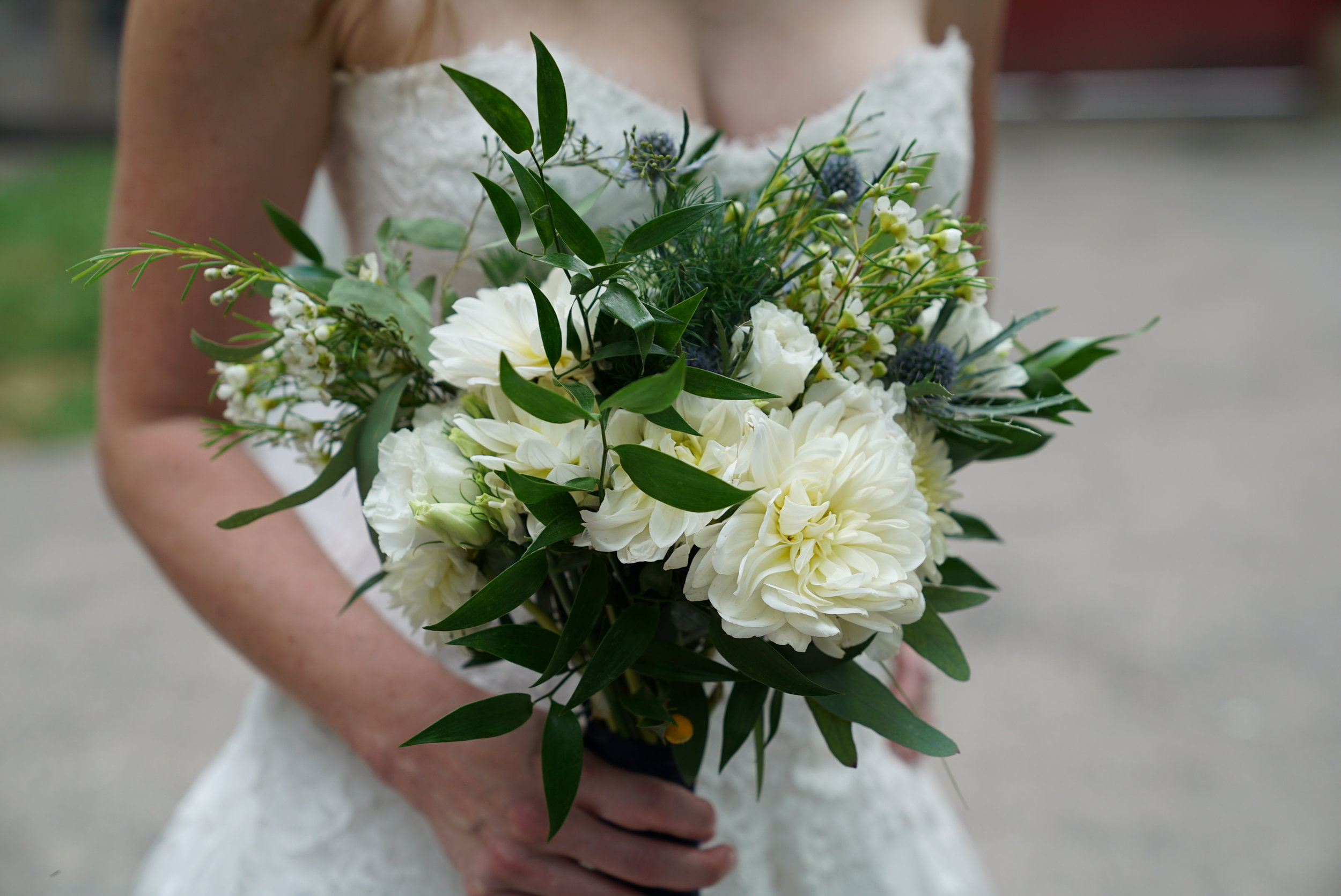 It's always hard to stop adding flowers into a bouquet, but with the bride being petite I wanted a nicely proportioned grouping. Again, Italian Ruscus shines as the dark green, with some Seeded Eucalyptus to lighten it up. I wish there were more reasons in life to carry beautiful bouquets around!!