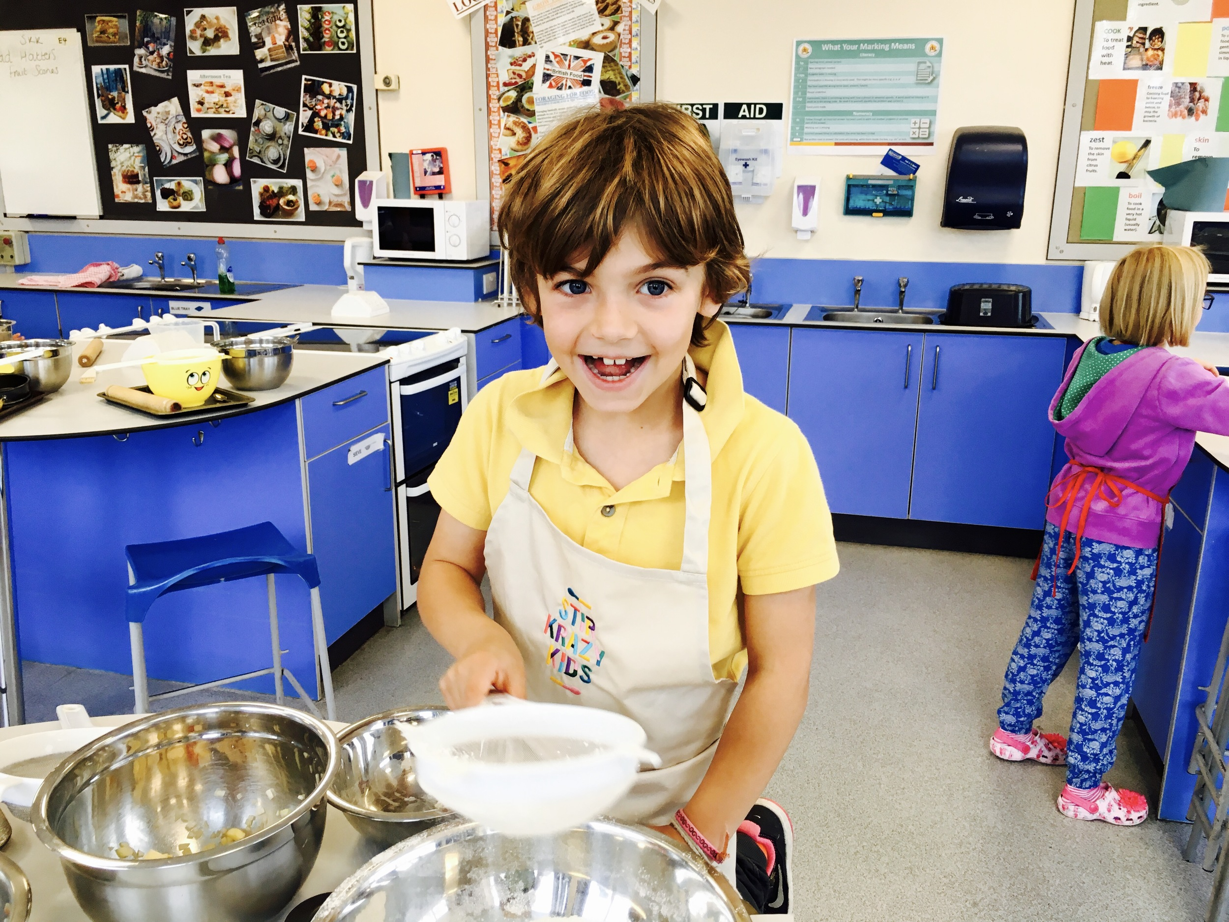 Big smiles as we sift the flour for our pastry!