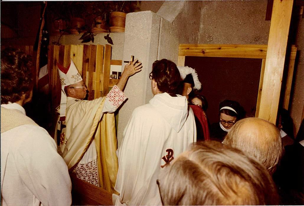 Archbishop Sheehan annointing the walls.