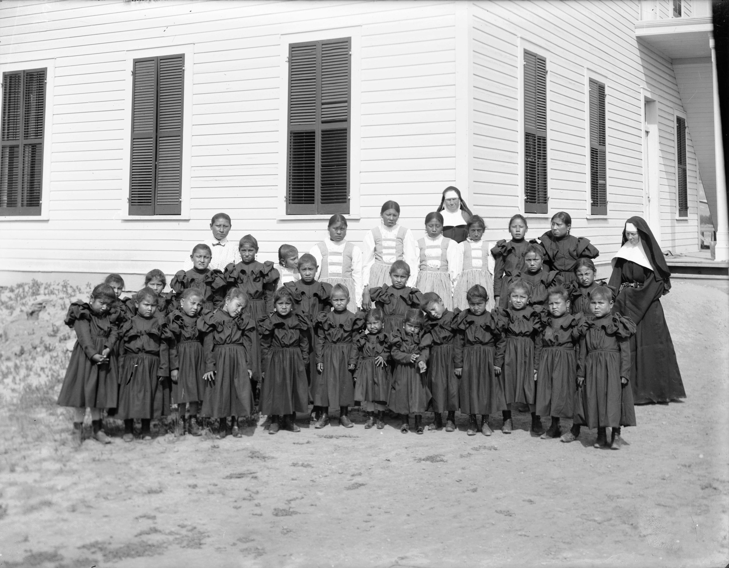 Children at Mandan Indian School 1900 courtesy of The Montana Historical Society Research Center Archives, Helena MT