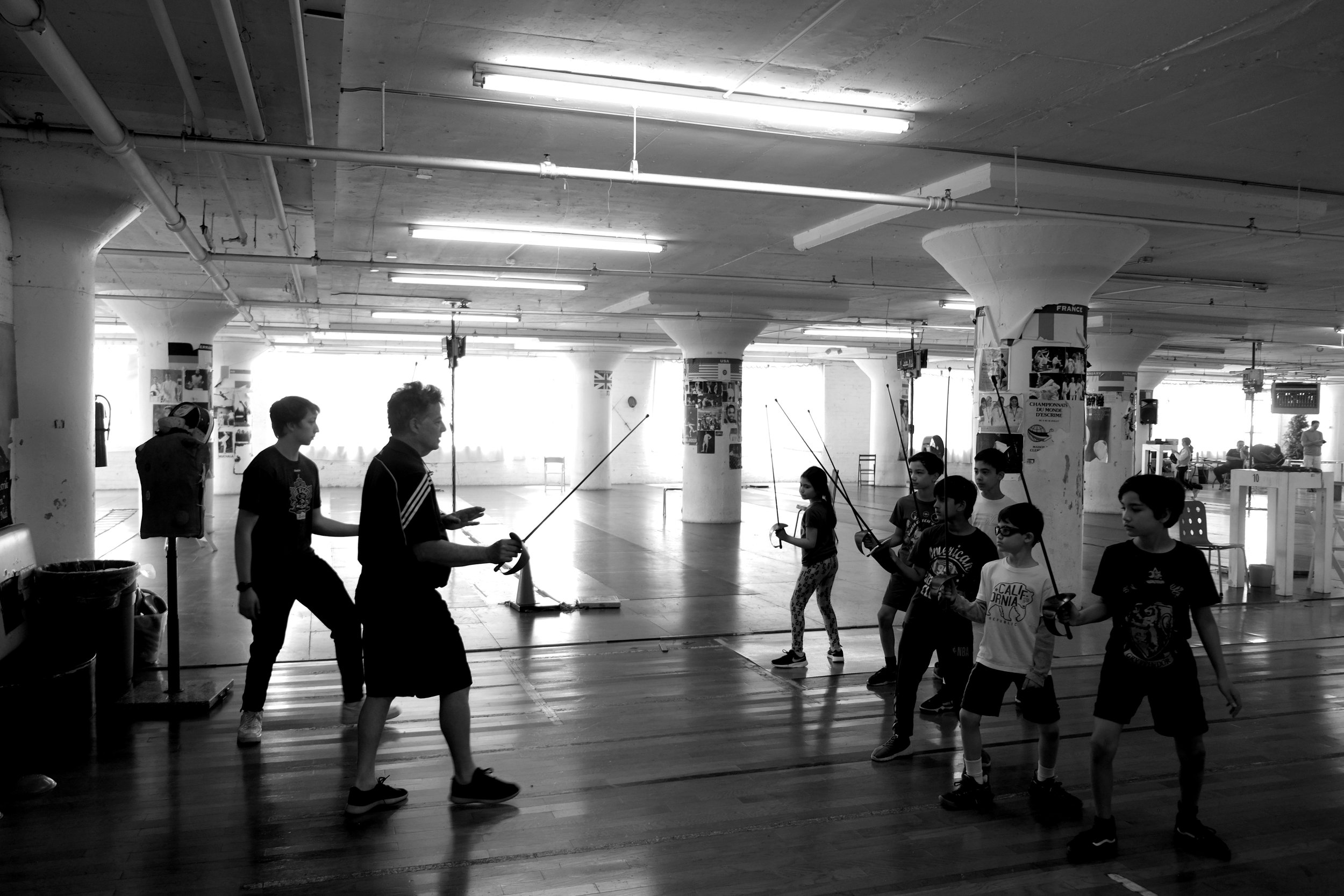 Steve Kaplan teaching at Cobra Fencing Club photographed by Debra Scherer