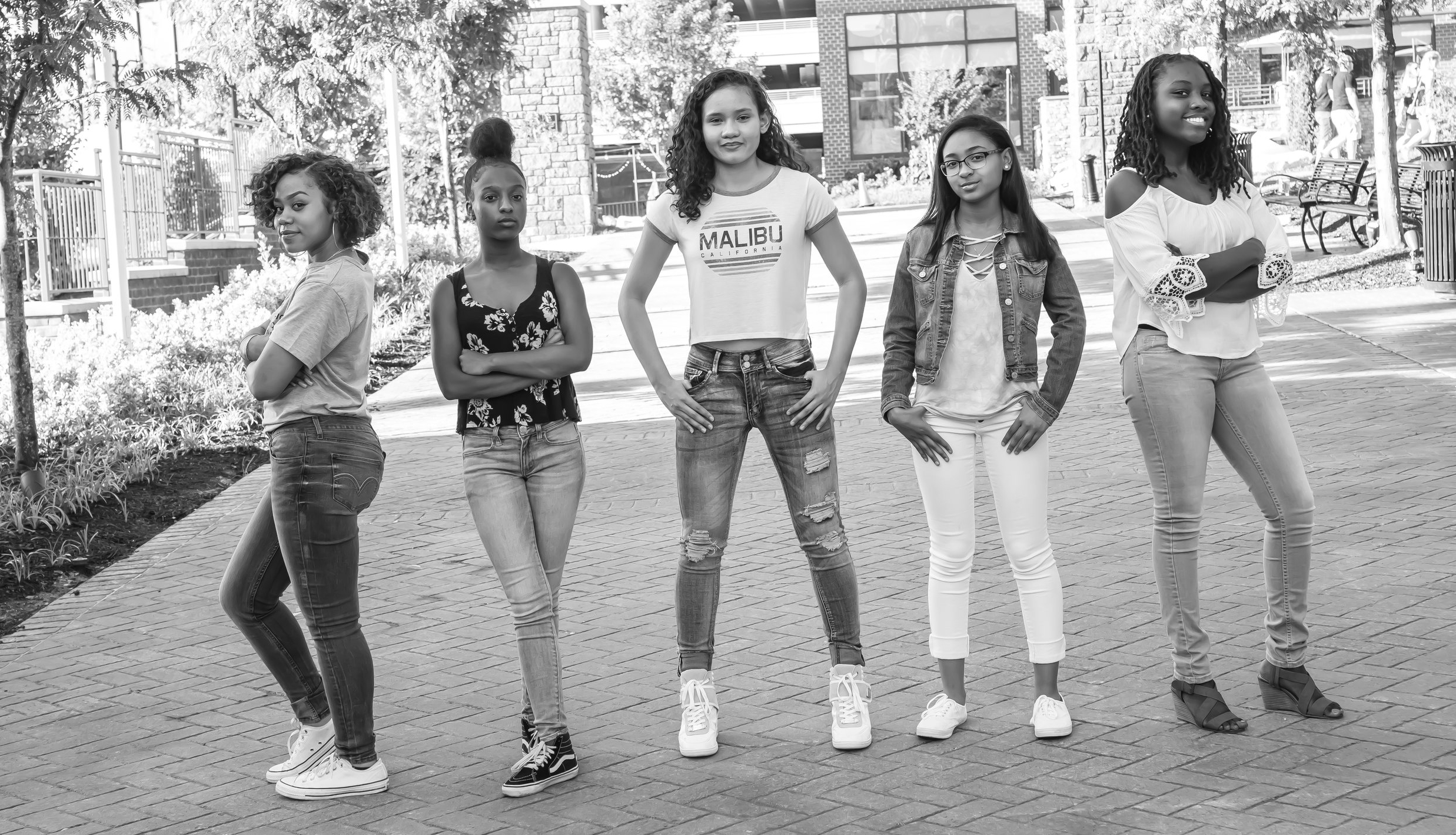 SHE - left to right-  Reyna  (vocals, keys)  Kaili  (cajon, percussion, vocals)  Leilani  (guitar, bass, keys, vocals)  Kaylyn  (keys, bass keys, vocals)  Amaya  (percussion, Roland pad, vocals)