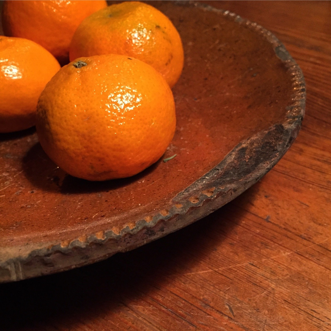 catherine-white :     Clementines on Pennsylvania Dutch pie  Plate.