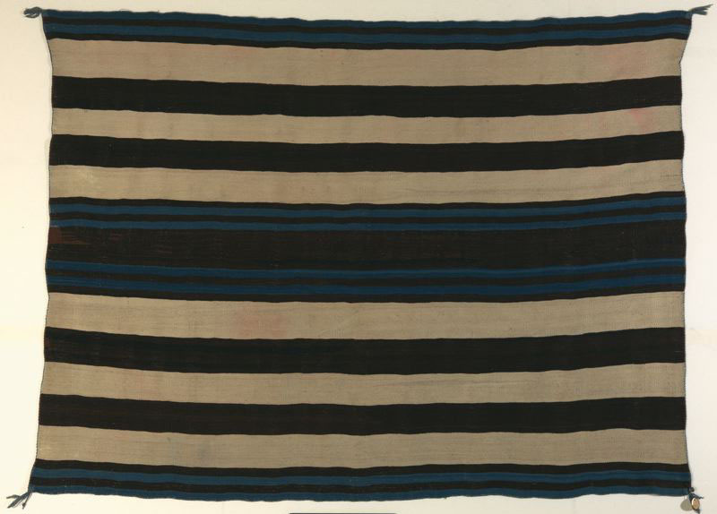 "deyoungmuseum :       Lines on the Horizon: Native American Art from the Weisel Family Collection   features multimedia Native American art from the southwestern united states, including this bold Navajo textile. Wearing blankets were actually worn in the style of a poncho. Known for their quality and purity of design, first-phase chief blankets represent the pinnacle of Navajo weaving. However, the title ""chief blanket"" is a misnomer: the Navajo had no chiefs. The term derives from the status of those in other Native American tribes, most notably the Plains Indians, such as the Ute and the Sioux, who wore this important trade object as a symbol of power and influence. Reflecting these trade relations, the earliest versions of the chief blanket are referred to as first-phase Ute style.     Wearing blanket (first-phase chief blanket, Ute style) , ca. 1830. United States, Southwest, Navajo. Wool; weft-faced plain weave, dovetail and diagonal join-tapestry weave, eccentric curved weft. Promised gift of the Thomas W. Weisel Family to the Fine Arts Museums of San Francisco. L12.103.17"