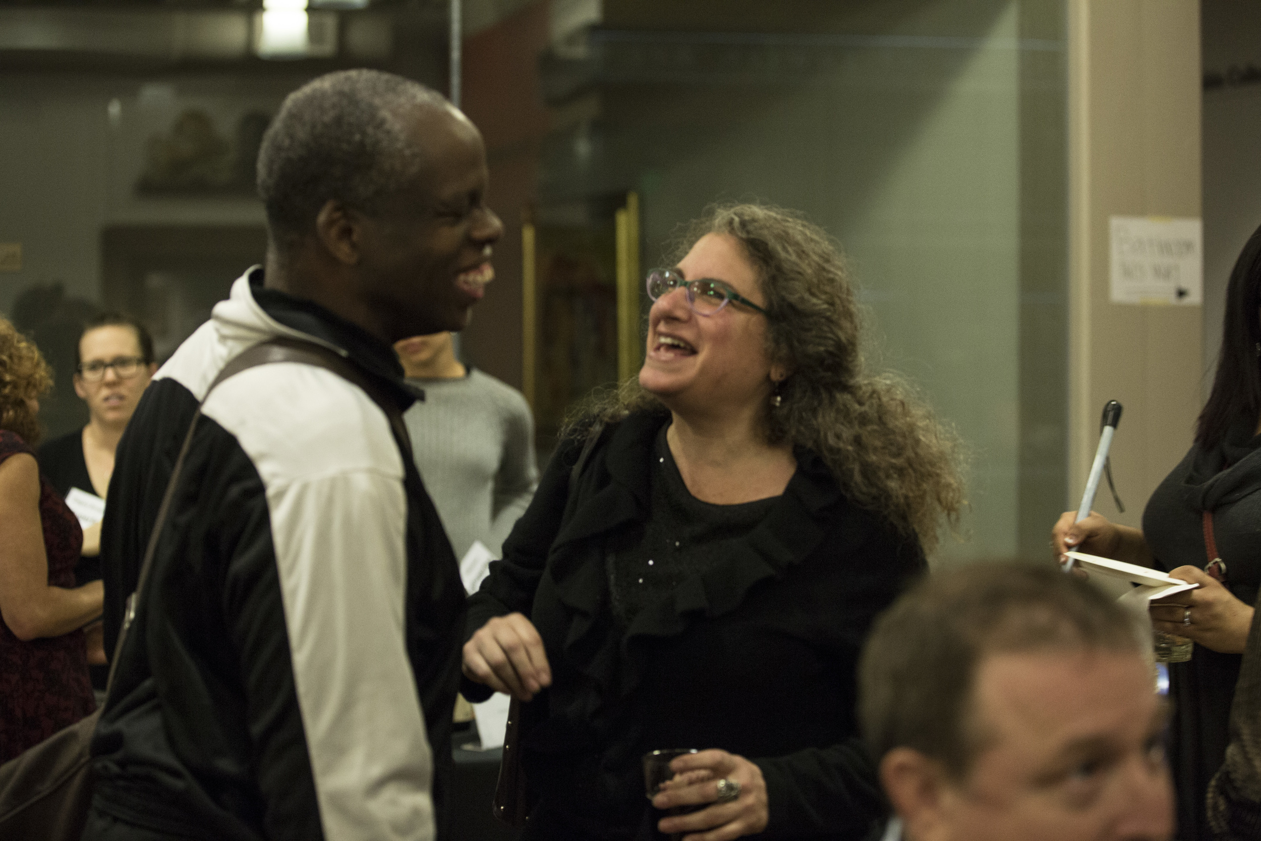 Superfest judge and filmmaker share a laugh at the Saturday night pre-party.
