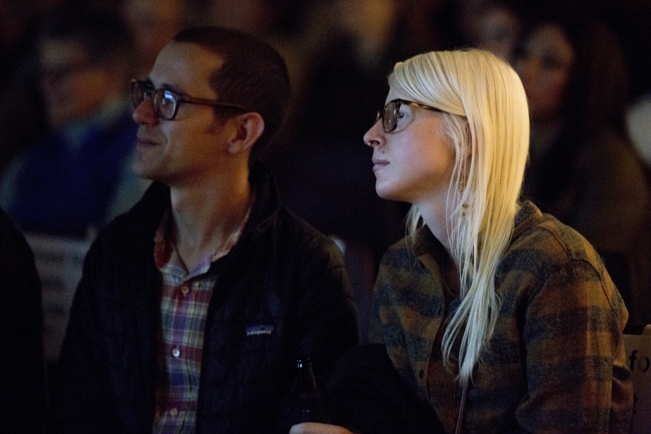 Two audience members take in Superfest's Saturday night films.